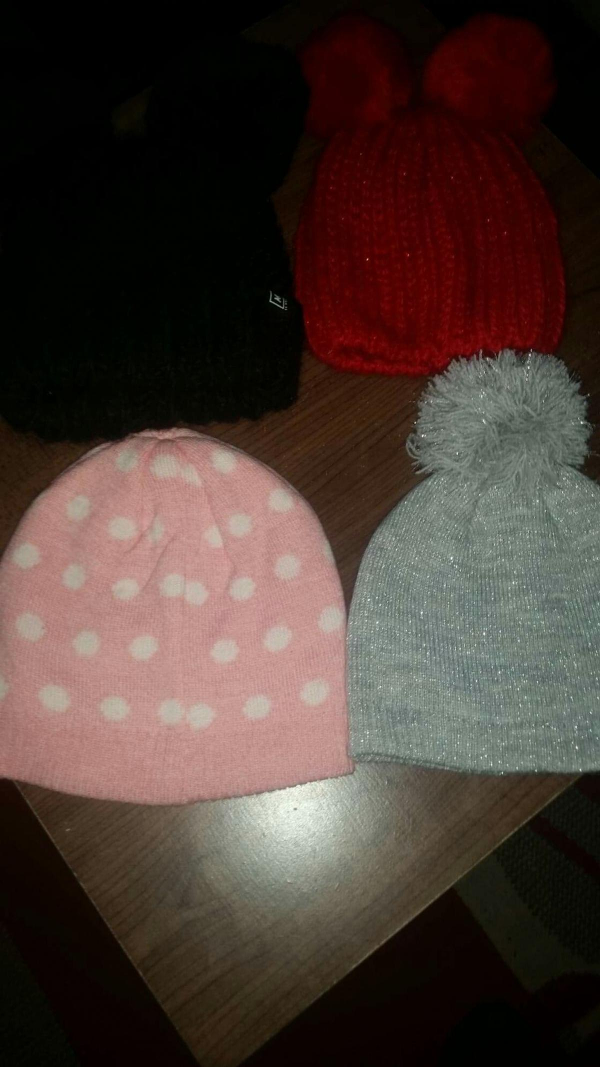4 hats in excellent condition. all from mothercare .. the black one is baby k by myleene klass