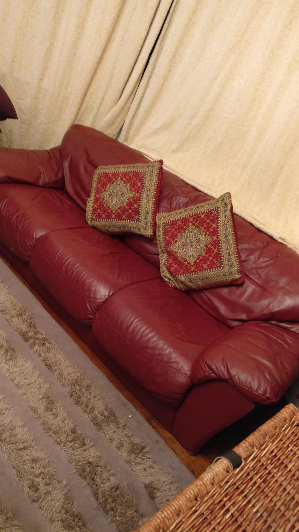 Good quality dark red leather sofa