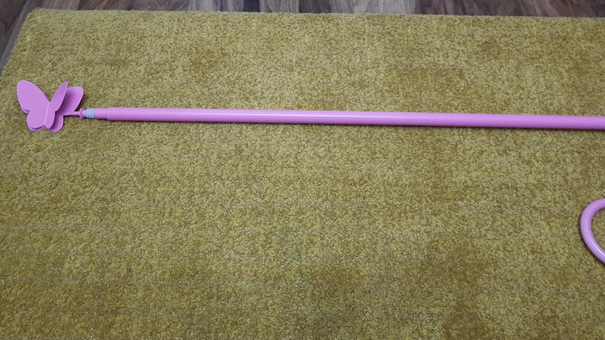 baby pink extendable pole butterfly design at ends couple minor scratched(from middle support bracket)