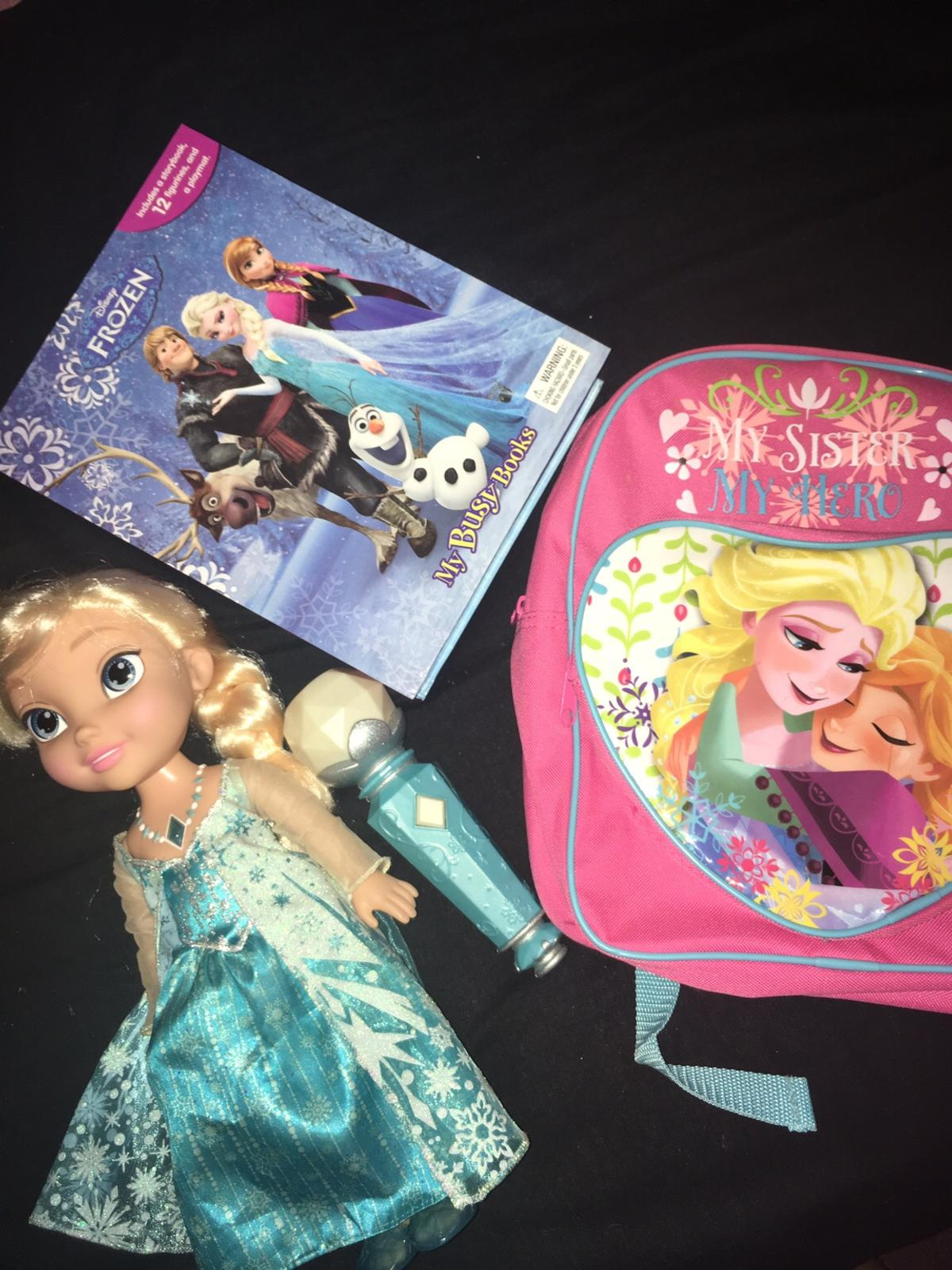 Elsa sing a long she sings and you sing back with microphone also story book with mat and figures and back pack must have for any frozen fan all like brand new