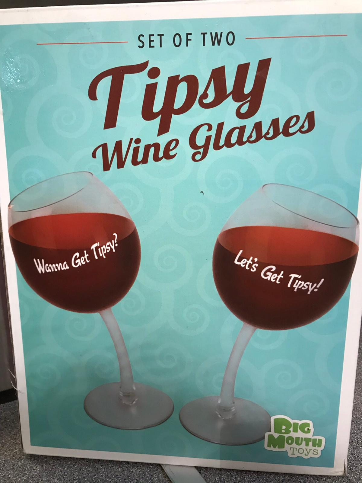 Funny wine glasses, with curved stems. Used but in excellent condition and in original box.