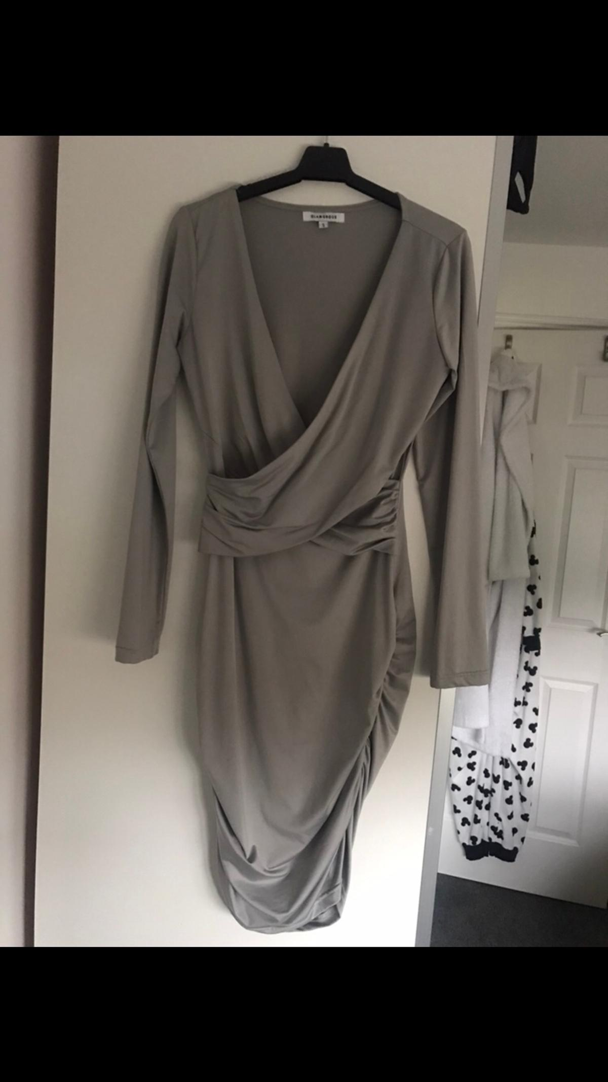 Silver mid length dress. Size small. Good condition. Worn once.