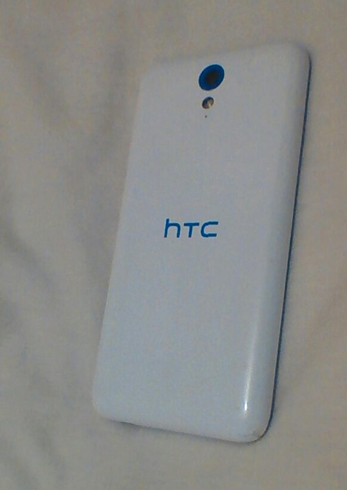 Brilliant phone. Has minor marks on corners and the screen is slightly cracked but does not effect the usage of the phone. No charger included only phone .