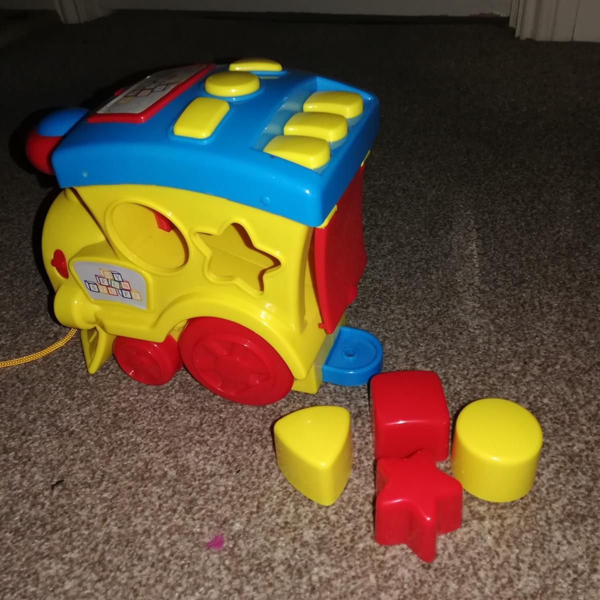 Pull along Train Shape Sorter with music & lights.  Collection only from Desborough