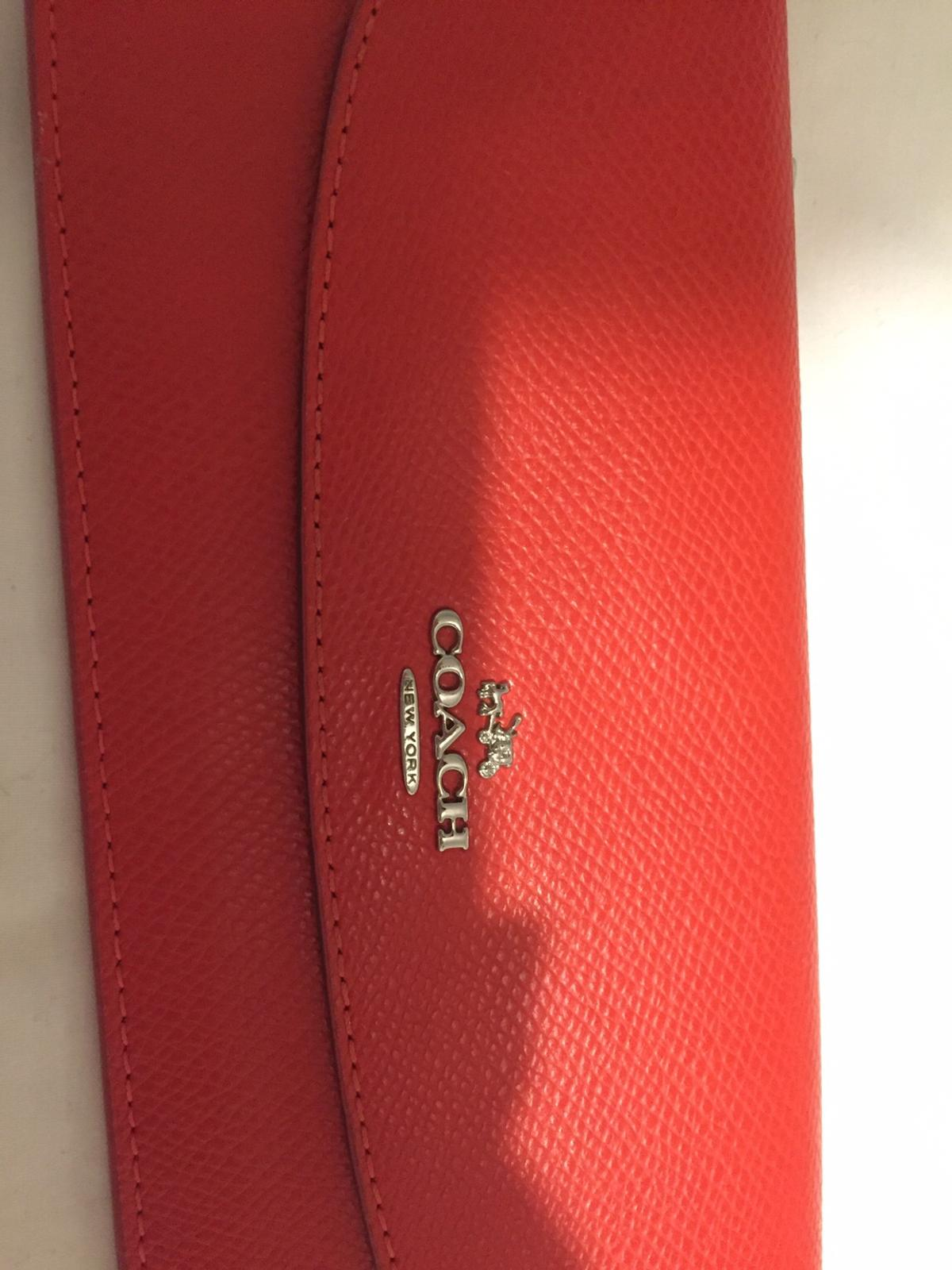 Rarely used authentic burnt orange coach wallet. Originally bought for £200 just over a year ago.