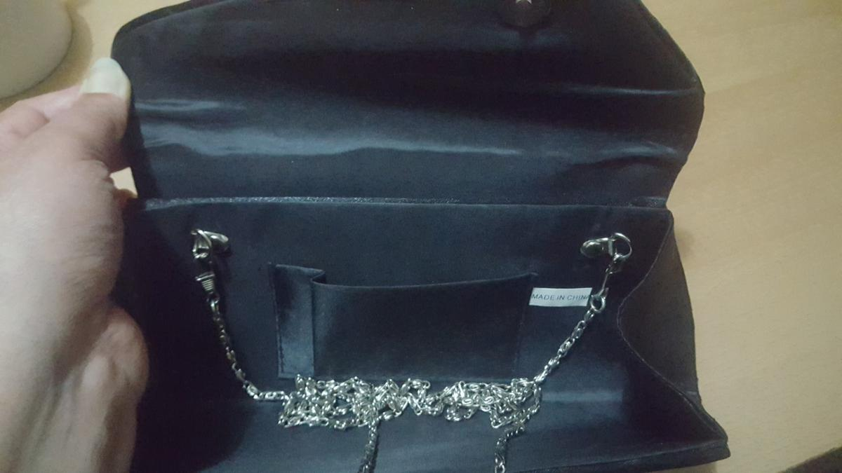 New Beautiful shiny beeded black bag for any occasion.