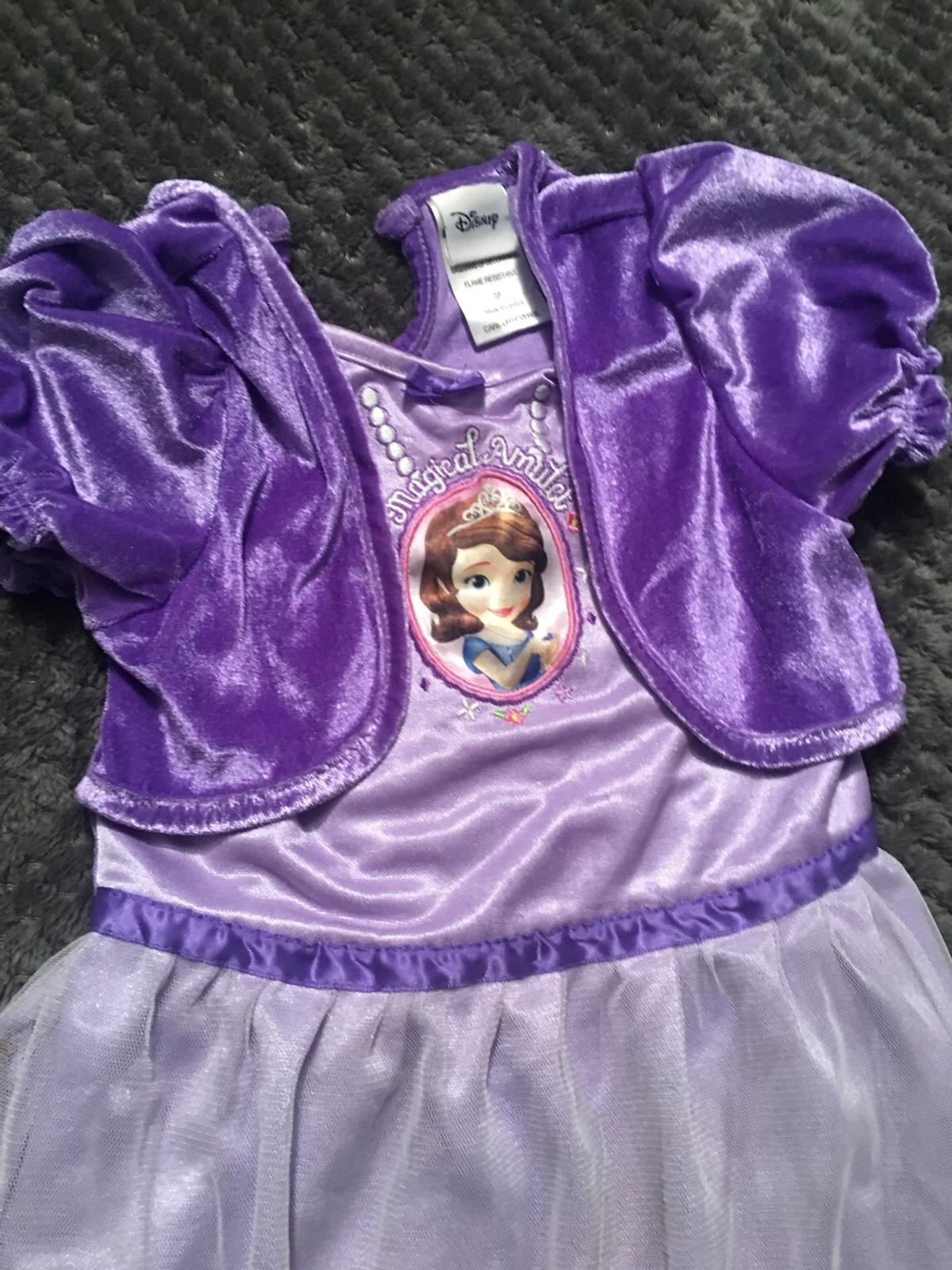 Beautiful crushed velvet on the waistcoat, sleeves and back. Polyester and net for the skirt. Princess Sofia face on her amulet. Mauve Color. beautful flower motifs at the bottom In good condition. Come and get it for book day!!!