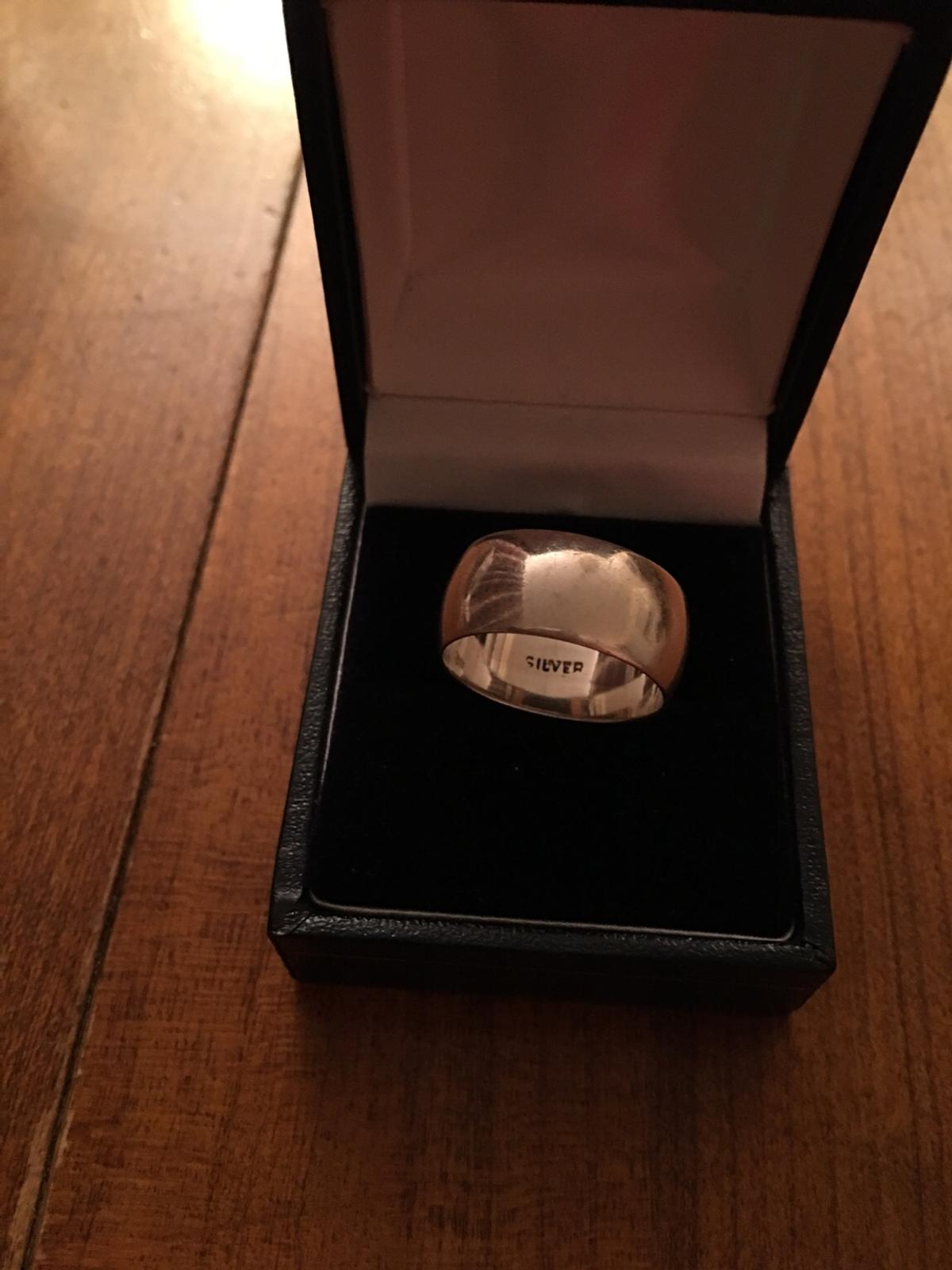Heavy solid silver wedding band, hallmarks Silver show in photo. Postage paid by buyer