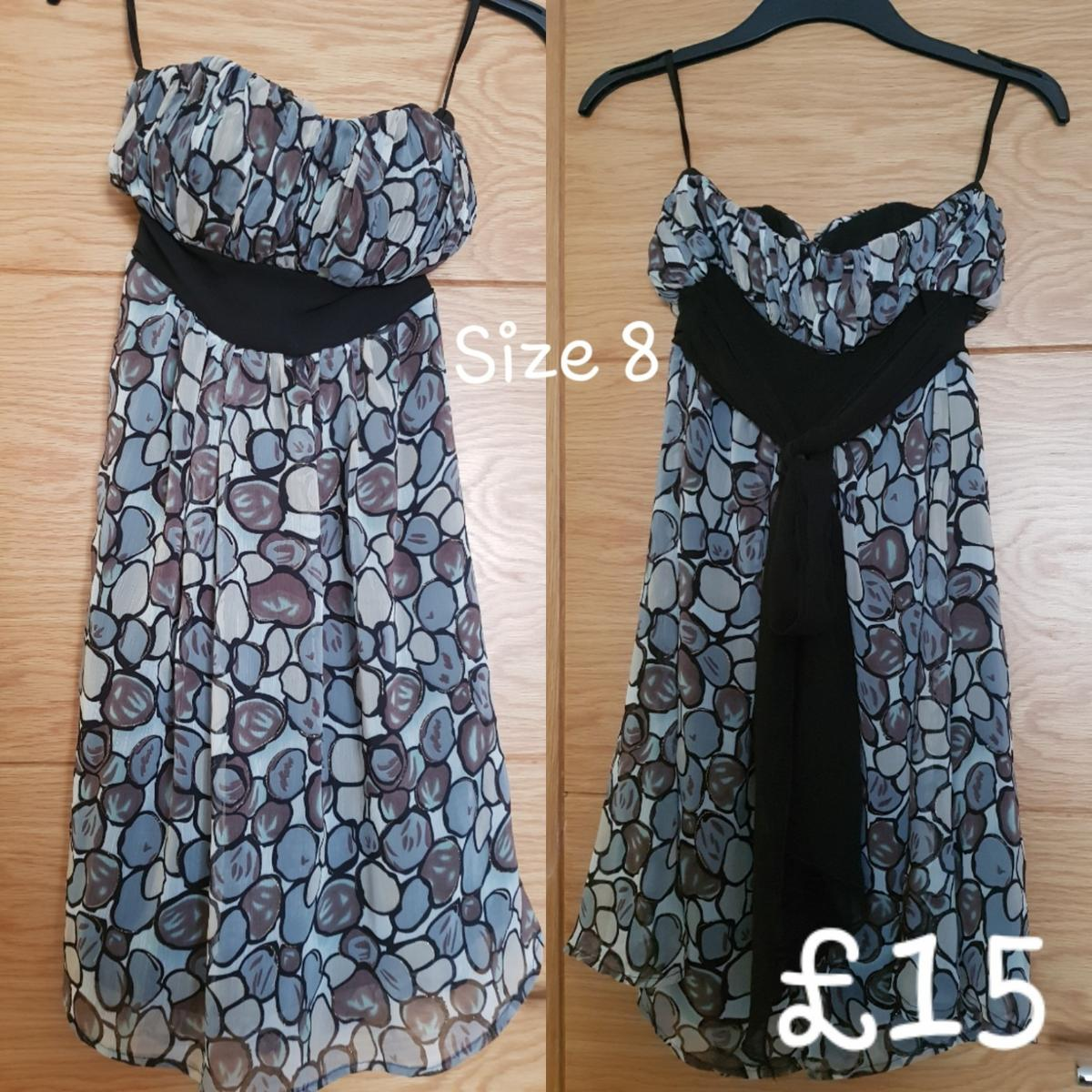 Size 8 Boobtube style and flowy with a tie up belt dress  In perfect condition - from a Pet and Smoke.  Collection or can be posted for additional charge