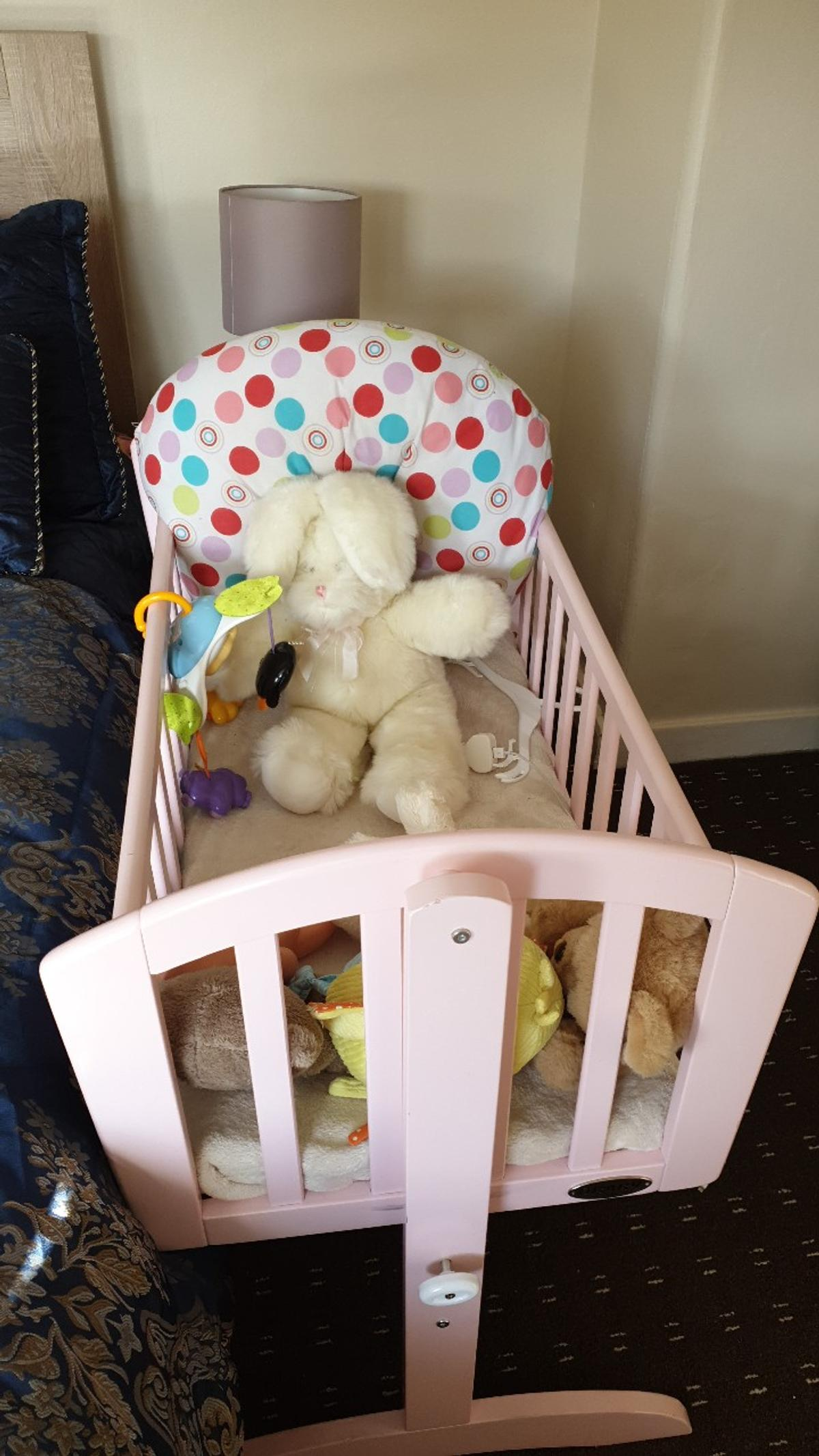 Pink baby crib used just a couple of months just a few scratches as shown on pictures from smoke and pet free home not selling with the mattress fr hygiene purposes
