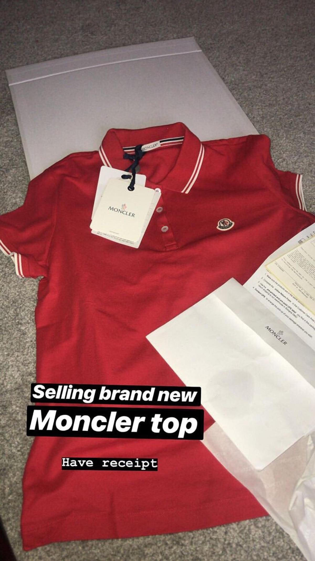 Brand new never been worn red moncler top , size Large . Still have box and original receipt