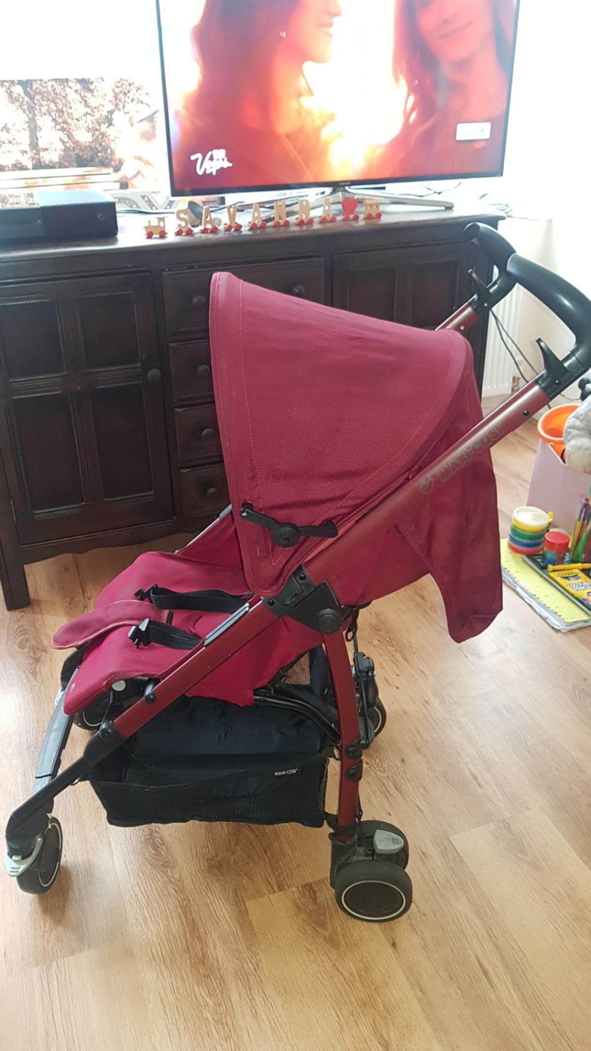 lightweight and easy to manouvre buggy. burgundy. Used for about a year, but no longer needed. still in very good condition.