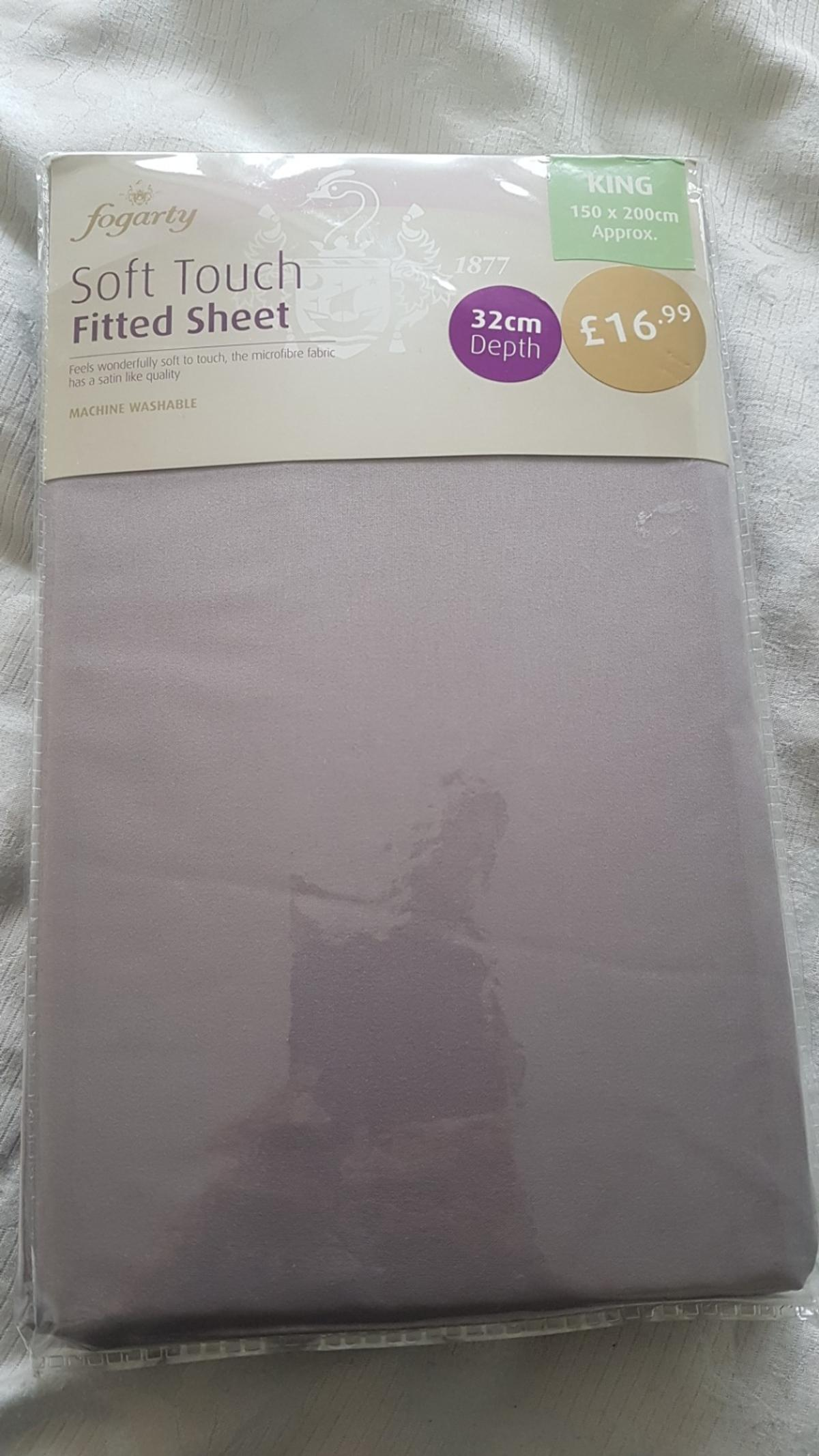 king size fitted sheet brand new also 32cm in depth, grey colour