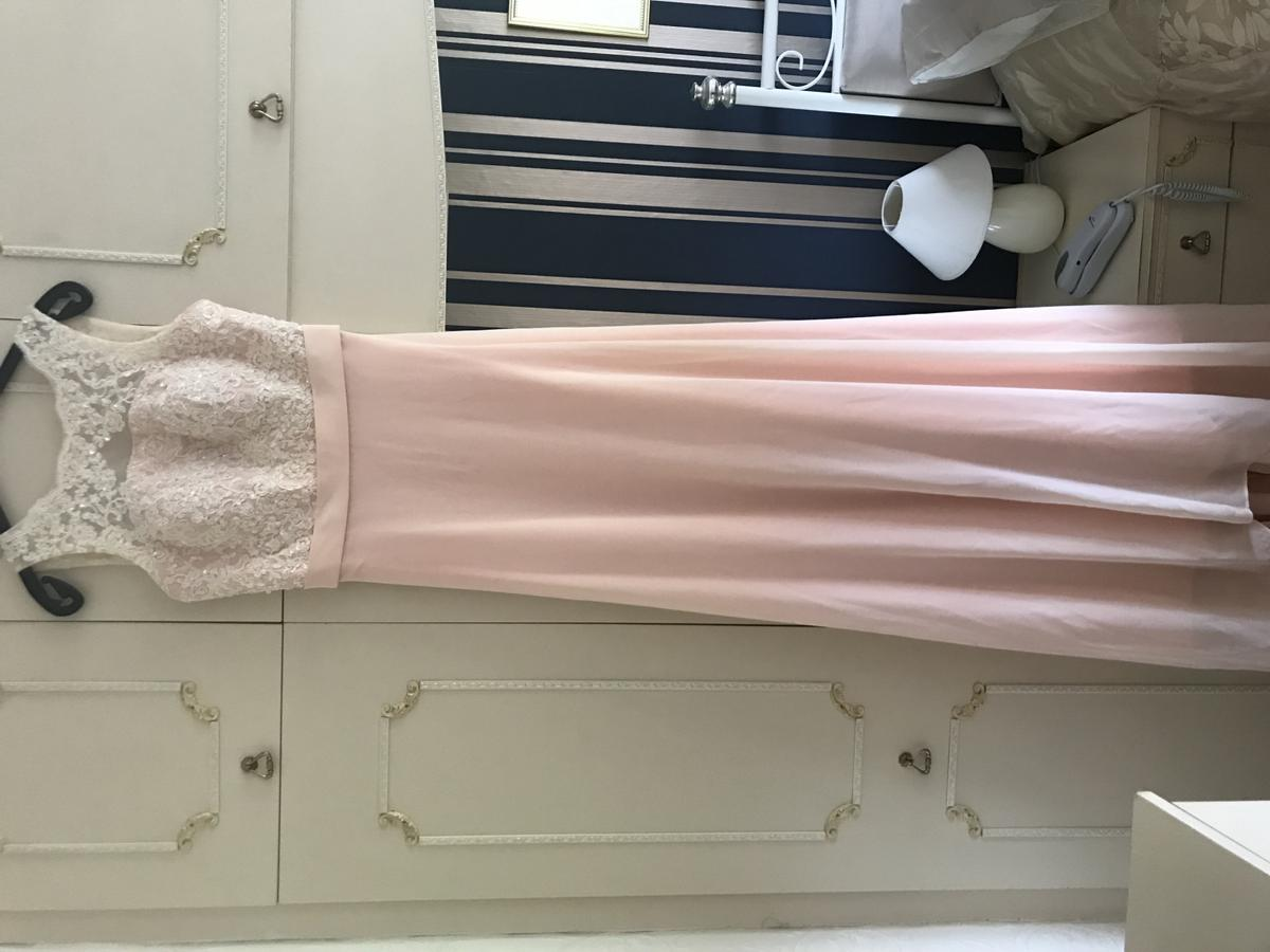 Beautiful peach/pink long evening gown - worn once for a wedding. Size 8-10 (Bust is padded - potentially would fit a size 12 with a B Cup) Backless with attached bow and a small train.