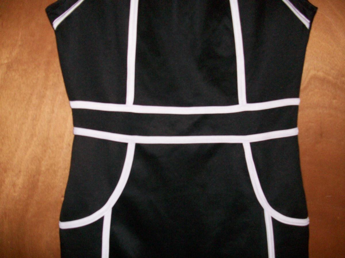 Brand new dress that hasn't been worn before little black dress with cut outs on the neck area.
