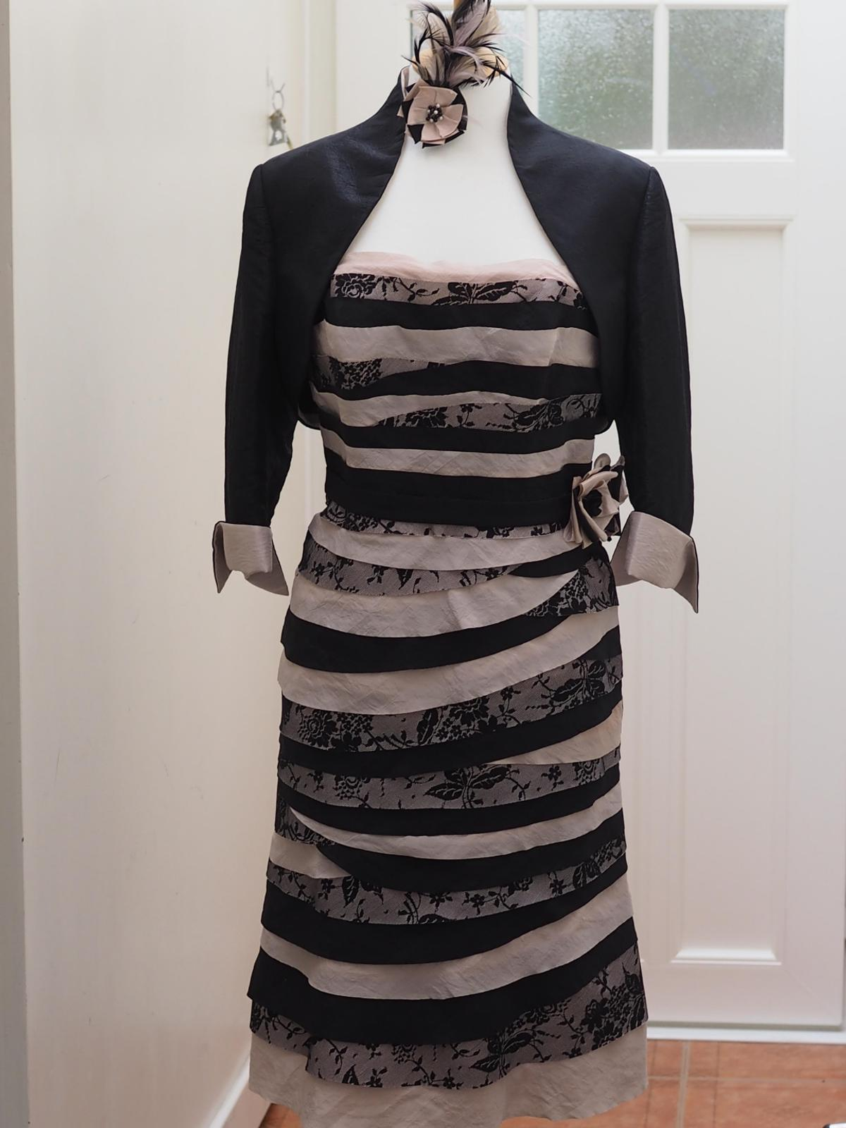Size 12, John Charles dress and jacket. Bought as a mother of the bride outfit but suitable for any special occasion. Fully lined. Dress material bias cut for flattering fit. Fascinator hand made to match. Cost £425, worn once. Comes complete with cover. Selling for £100 ono. Facility to try on by arrangement. We are a smoke and pet free home. Buyer collects from MK41 Bedford
