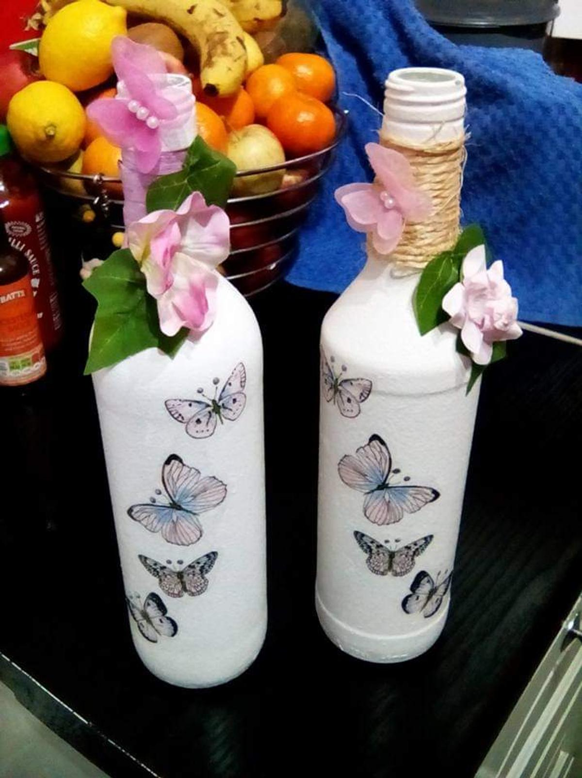 Butterfly bottle vases various designs £5 each