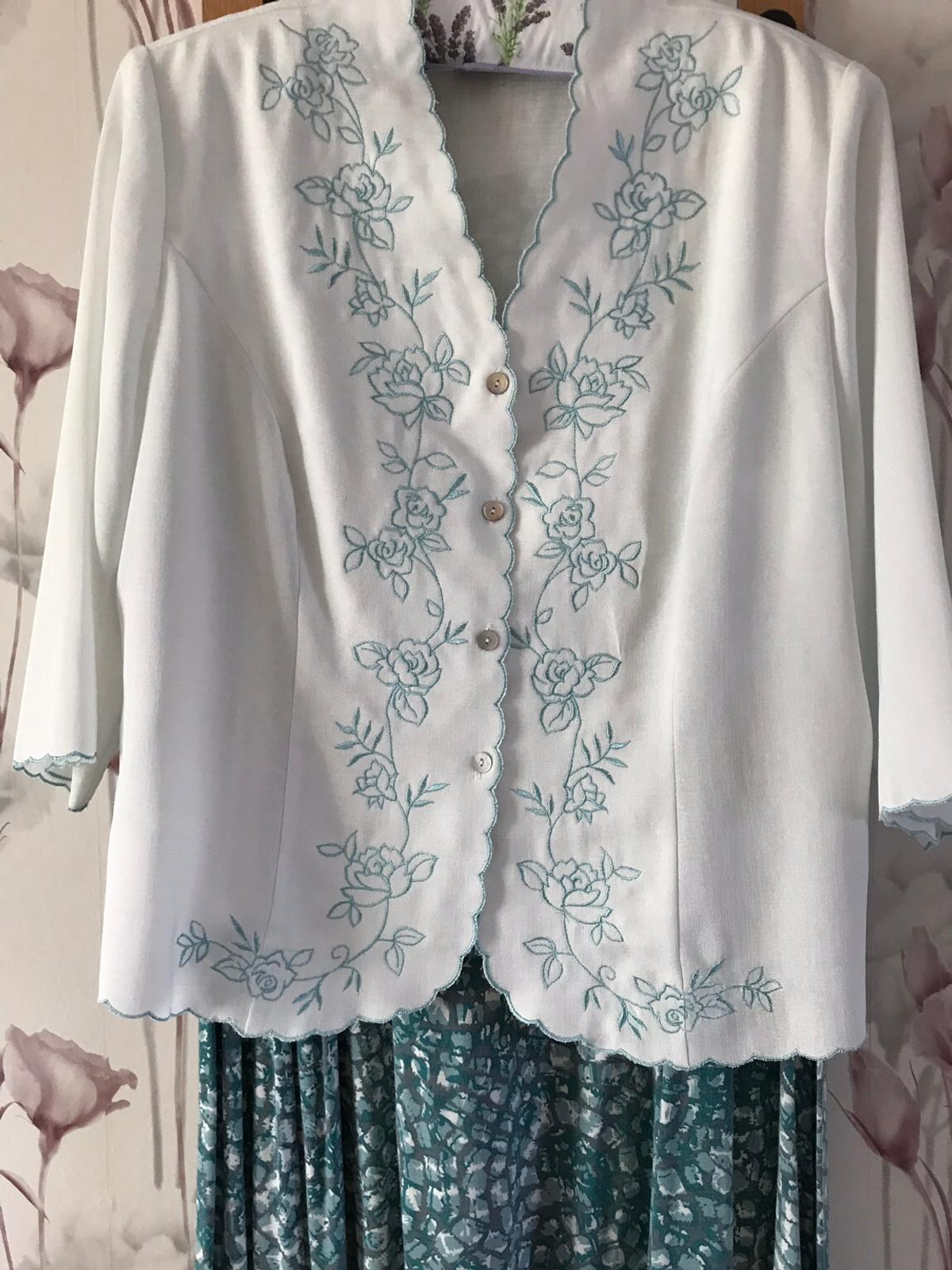 Duck Egg blue eastex jacket with white blue edged blouse, and half elastic patterned skirt. Size 18. Very good condition. Also hat, handbag and fascination available to buy separately.  Collection locally only