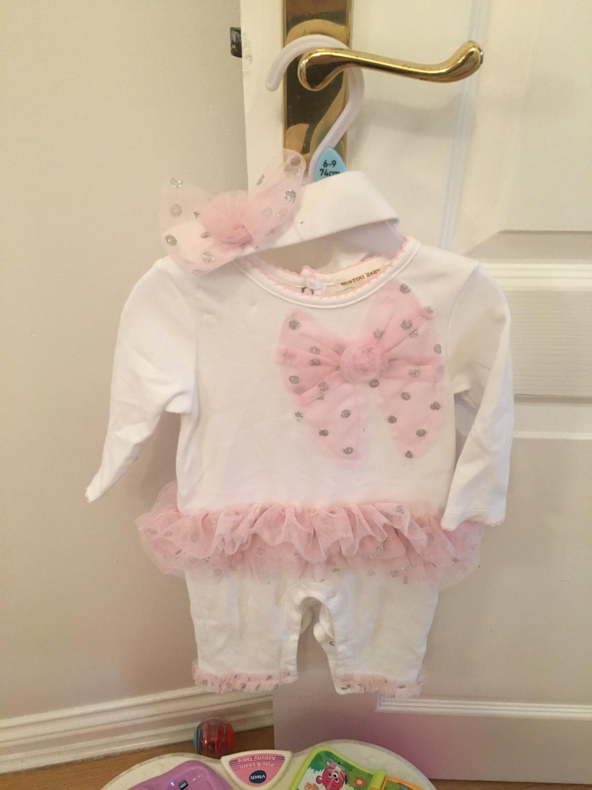 Boutique romper suit with matching head band 6 months