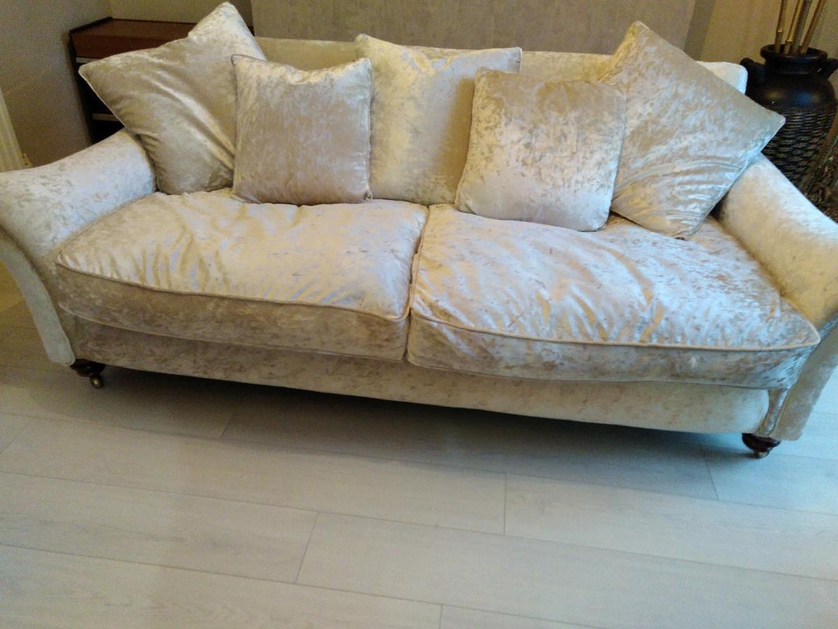 champagne sofa very comfy three months old it has wood casters foot cussions can be turned of both sides cussions all zip of pics don't do anythink for this it must be seen it cost me £1200 selling due to just decorated and does go with my decore