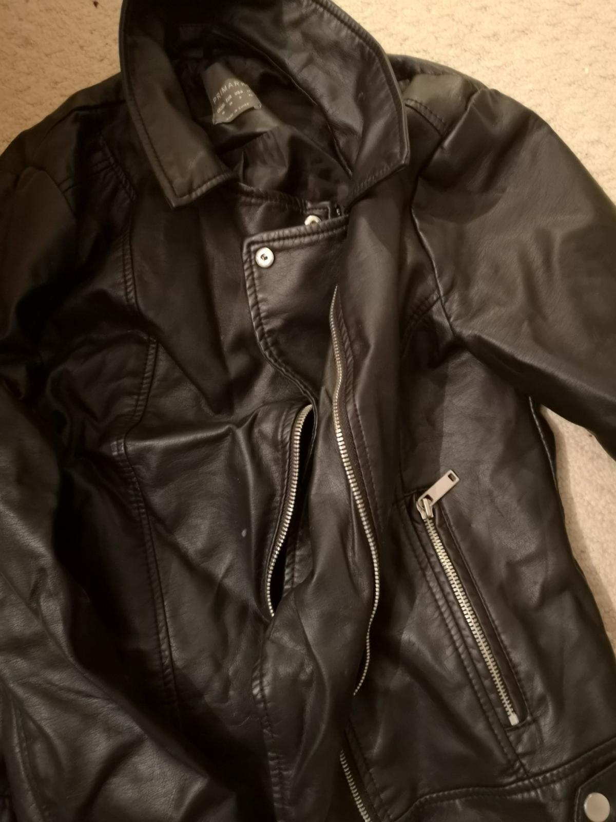 Woman's black fake leather jacket, size 10 worn a handful of time, good condition. Happy to send more pictures