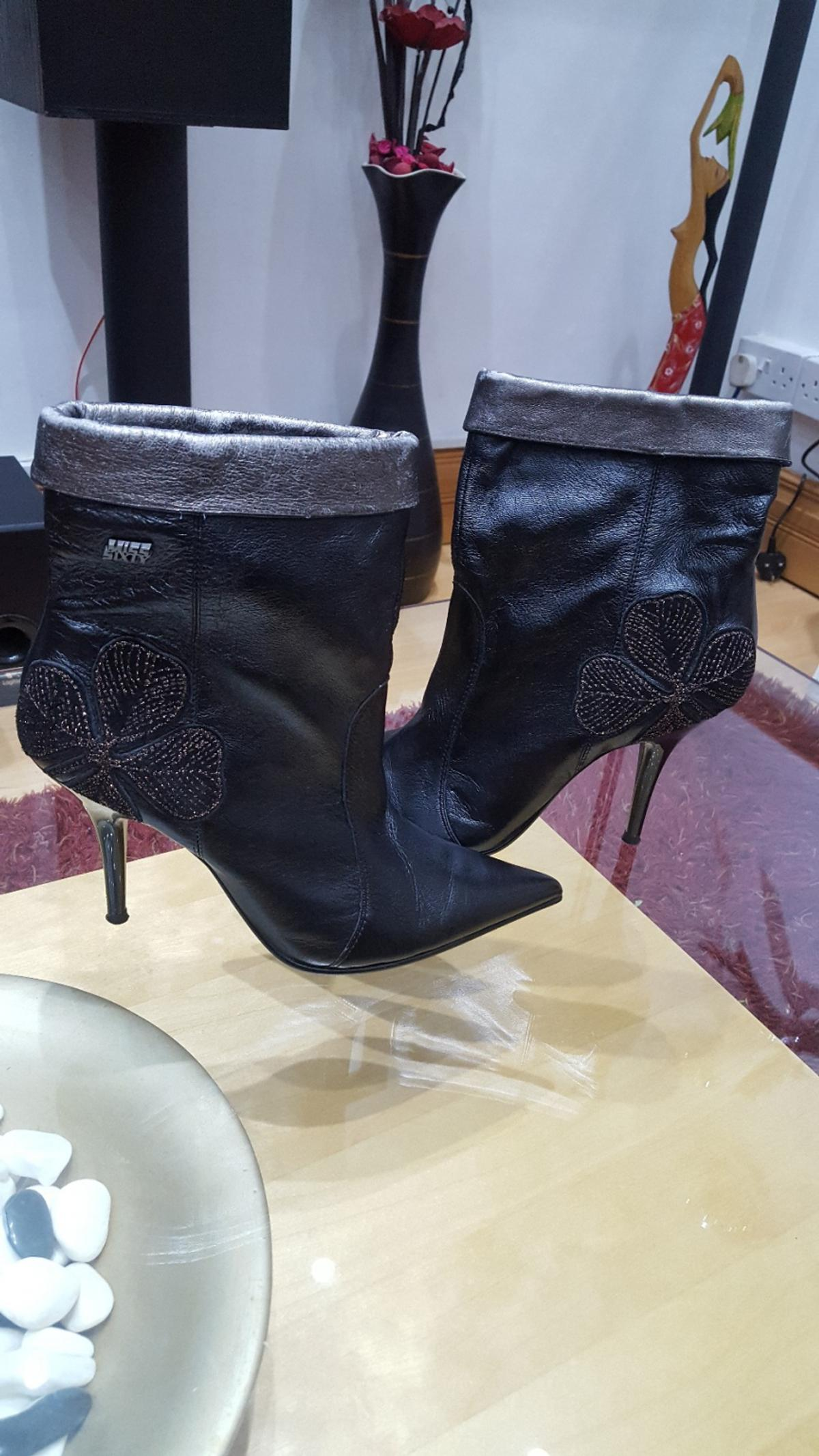miss sixty black leather ankle boots with fancy side shamrock design size 40 which is size 7 worn once excellent condition. original price 135 selling for bargain price 35 pounds