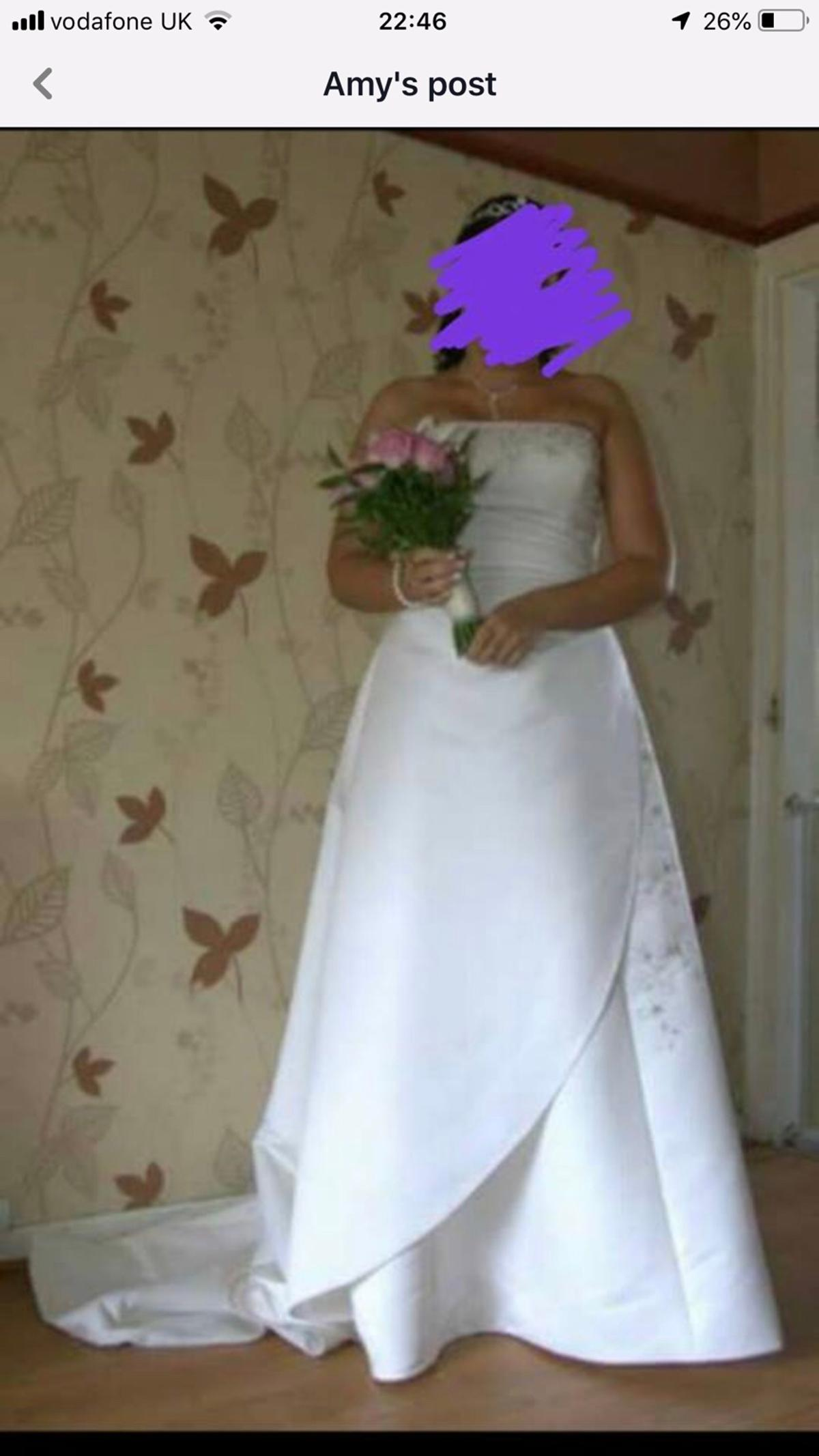 The dress is size 12/14 it's in ivory colour with light pink (pale pink) detail across the chest and down the side,with long train  It's a zip fasten but with the button effect look Beautiful and pictures do not do justice  Will need a dry clean hence the price no stain or marks (just general ground marks from wearing on my wedding day) selling for £100 will cost roughly £100 to have dry cleaned  Any questions please ask :)