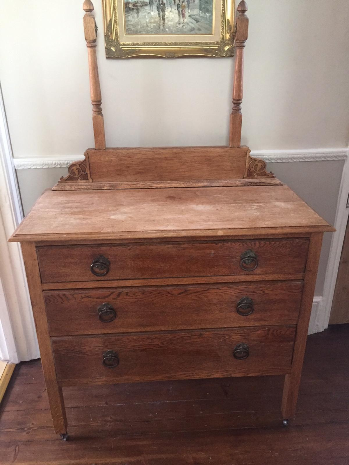 Solid Oak well built Victorian dressing table. Just needs new glass on mirror board. Lovely project. Dimensions-92cm (L) X 44 (D) X 82 ( H)