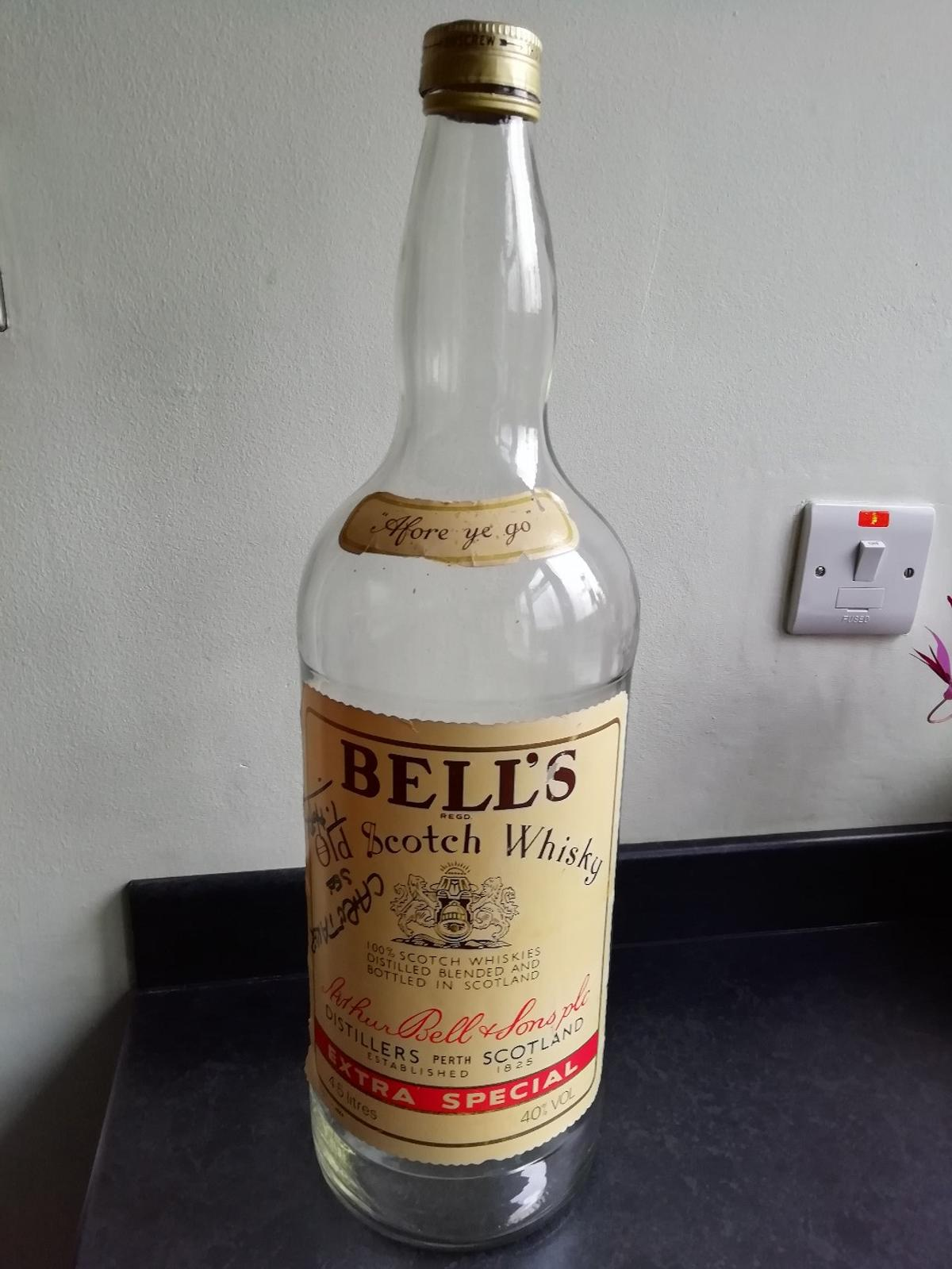 Bells whiskey bottle screw thread does not tighten, but in good condition.Not sure of it's age .