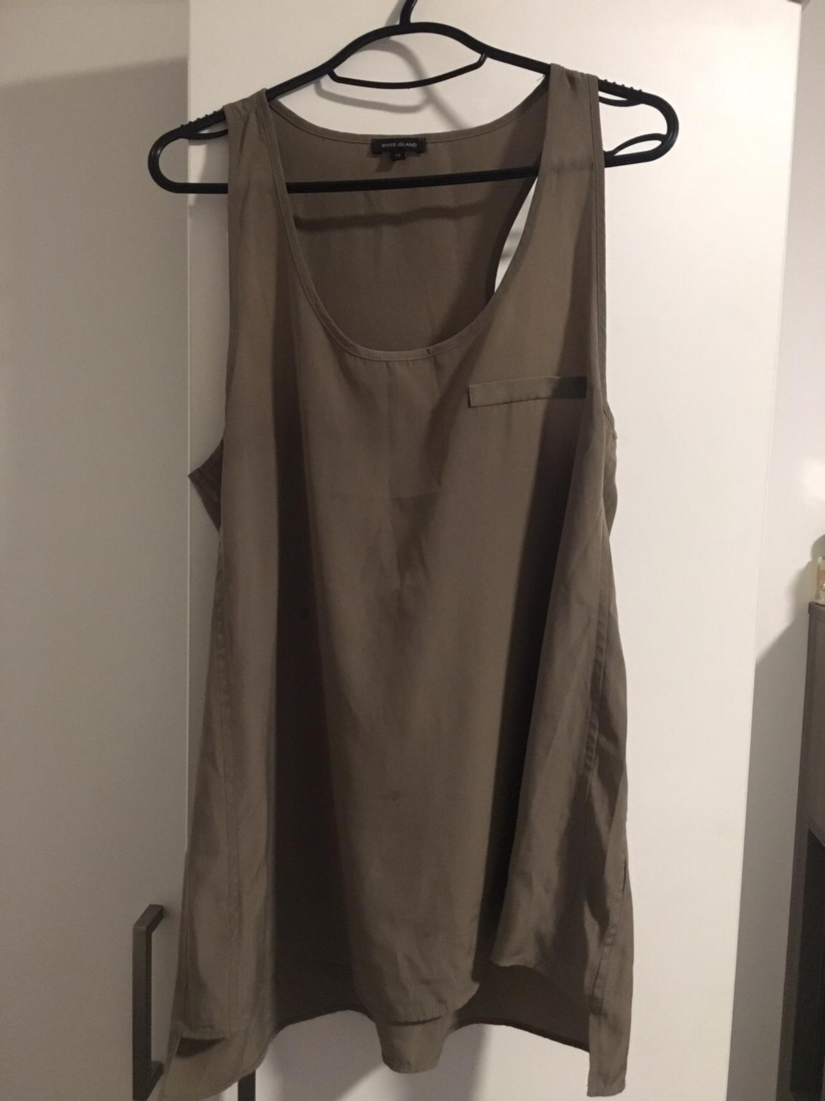 Khaki Size 8-12 Oversized River island Originally bought for £26 Worn twice. Great condition