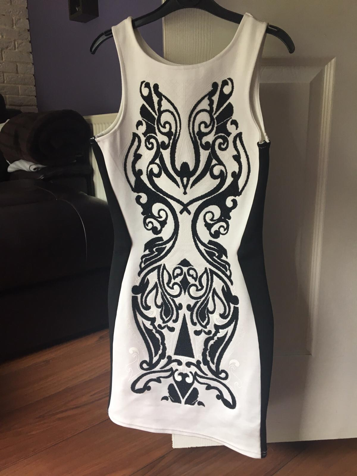 White & black bodycone dress Pink bandage dress Both in perfect condition Size 8