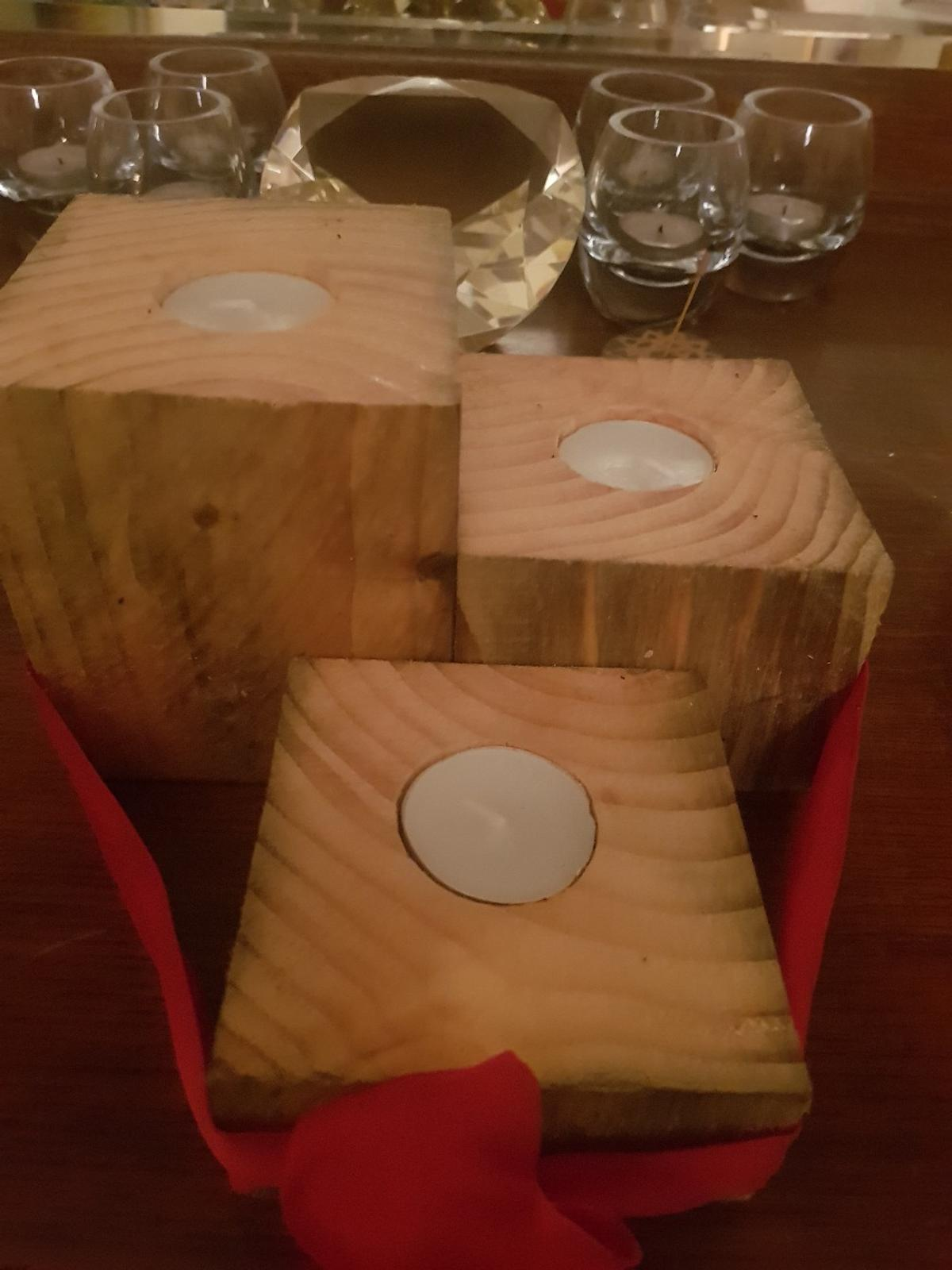 3 wooden candle holders