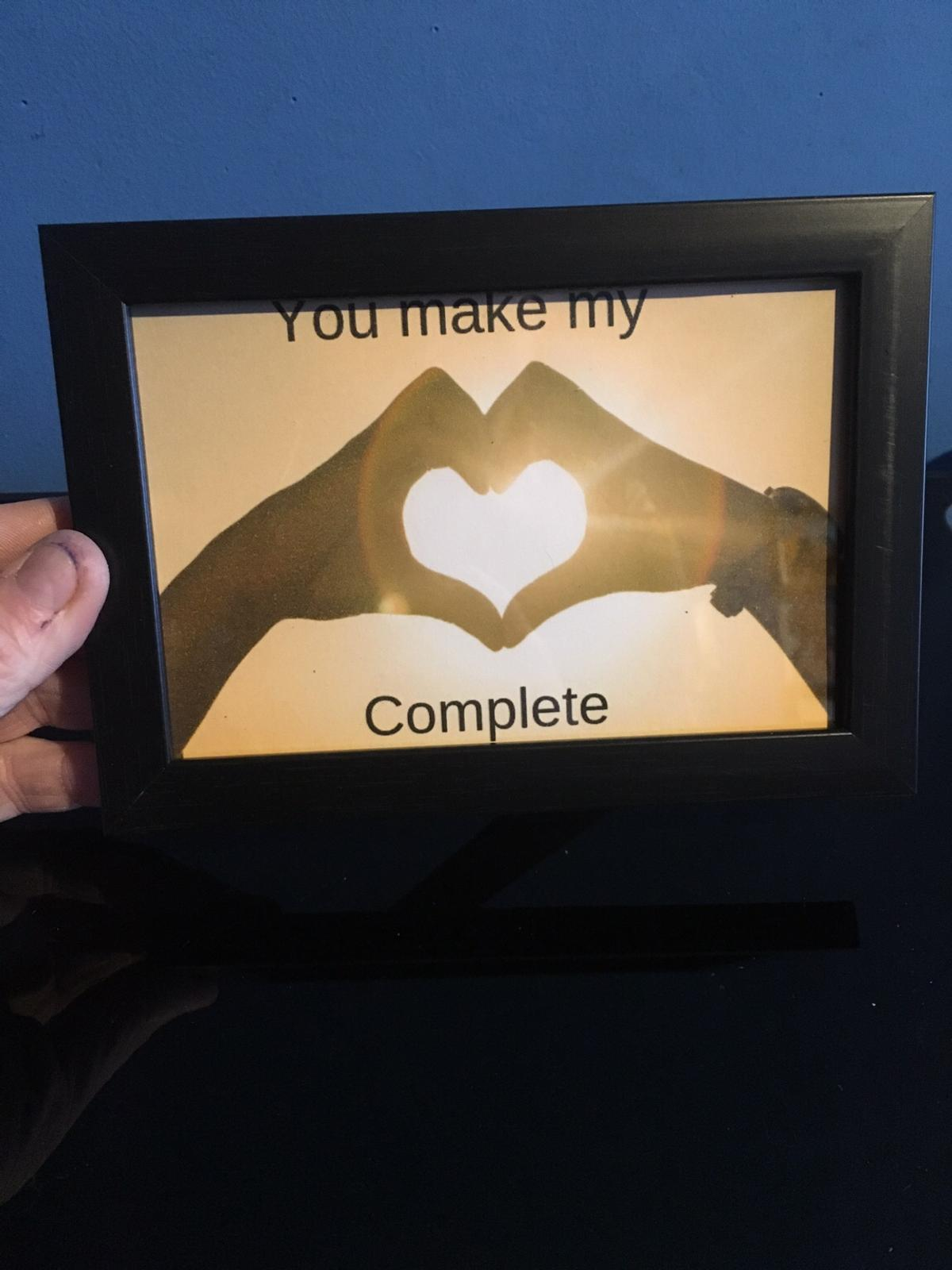 """card printed with the message """"You make my (heart shape made of hands) complete""""  The card is mounted in a frame  Postage £3 on top to cover second class Royal Mail - payment for posted items to be made thru Bank Transfer"""