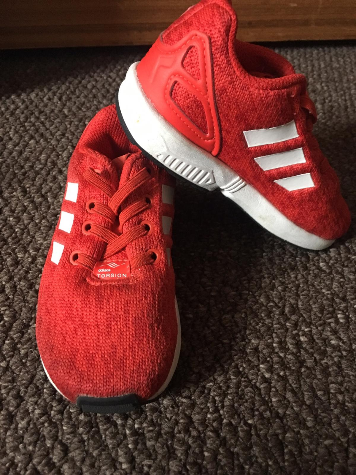 size 40 e1a3a fd46a Red Adidas Flux Trainers