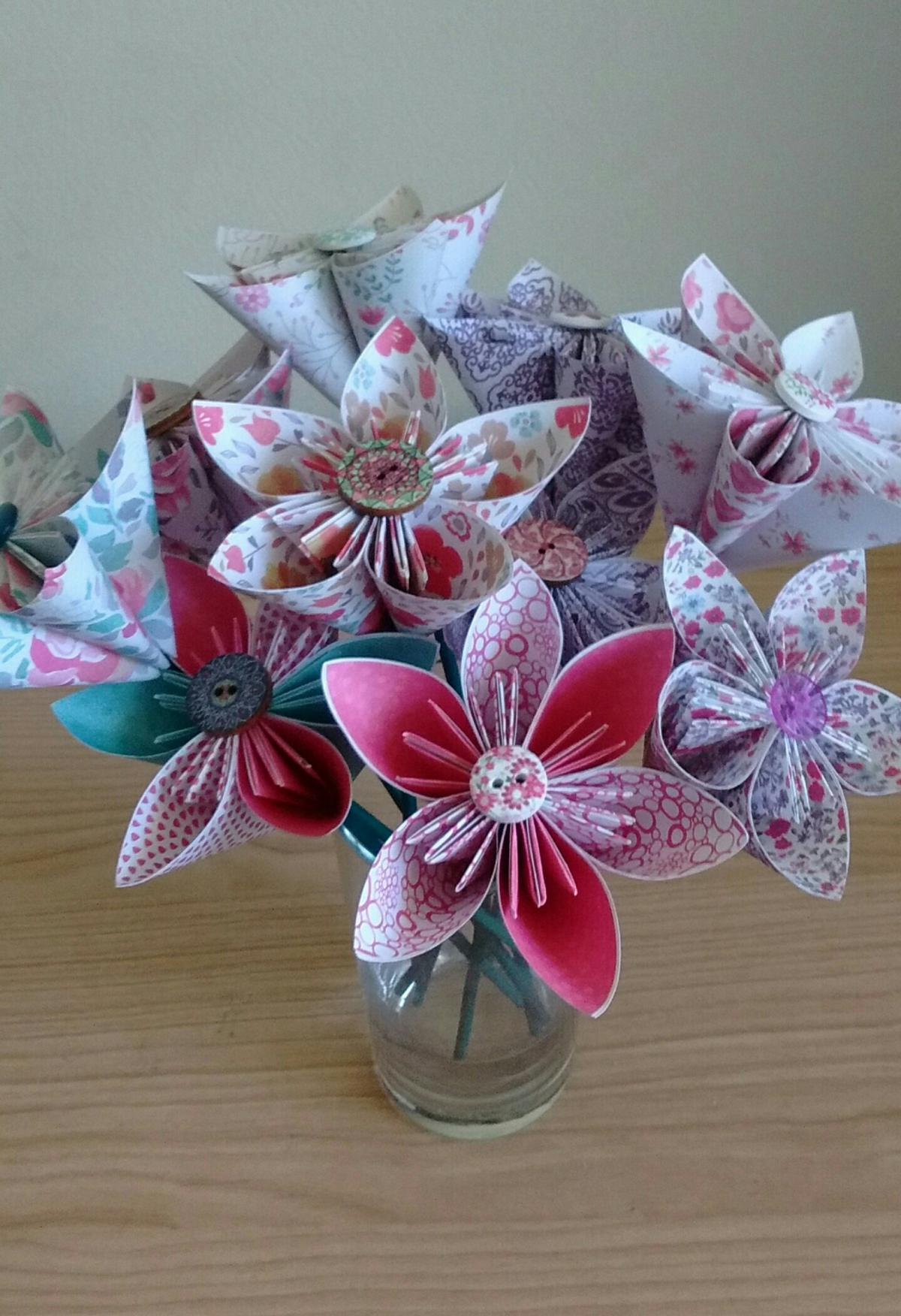 Multicolored Paper Origami Flowers On Pastel Background. Studio ... | 1752x1200
