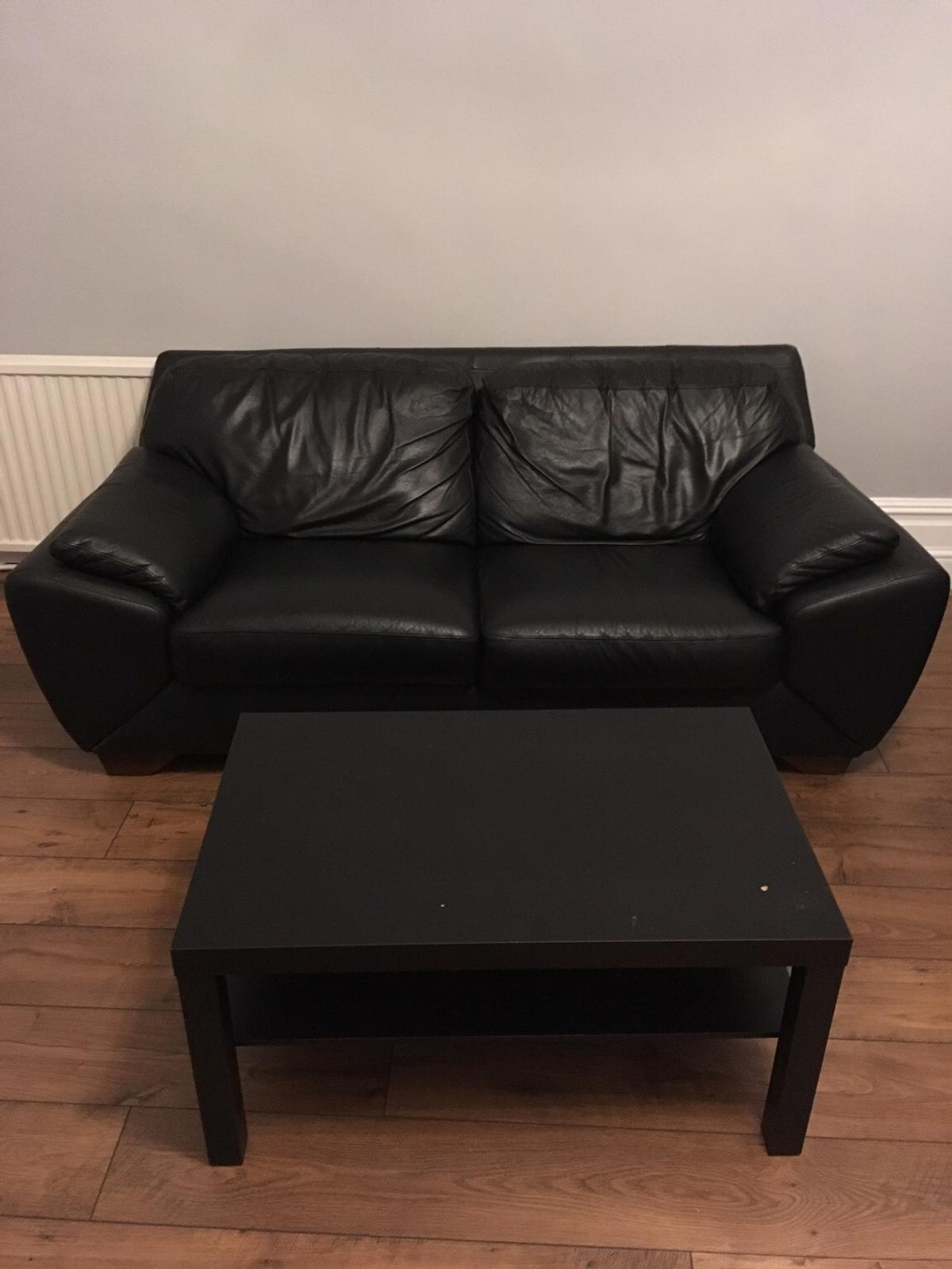 Comfortable black leather two seater sofa