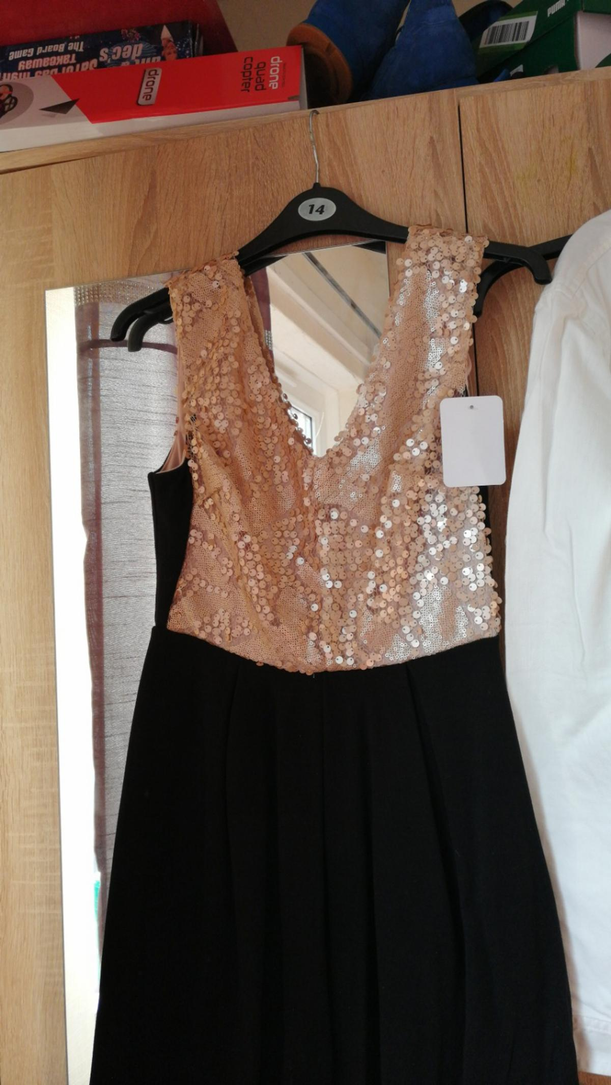 sequin and black dress