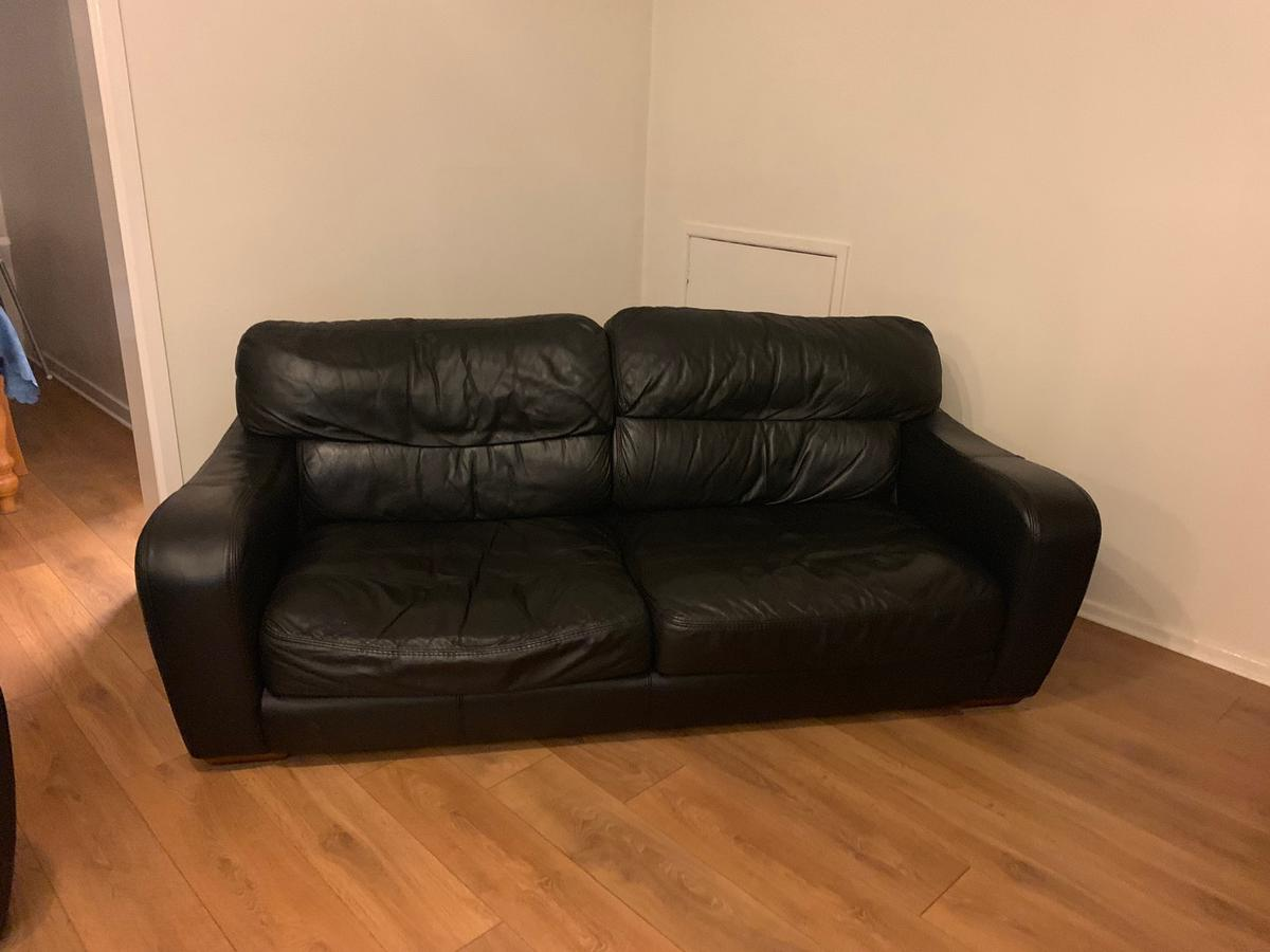 Black leather sofa and armchair in Bury for £75.00 for sale ...