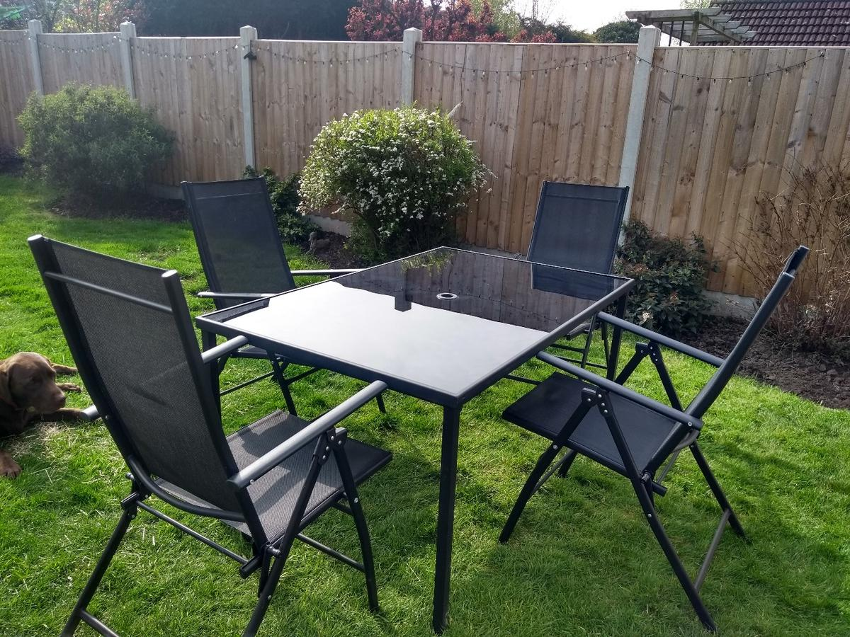 Black Glass Garden Table and Chairs
