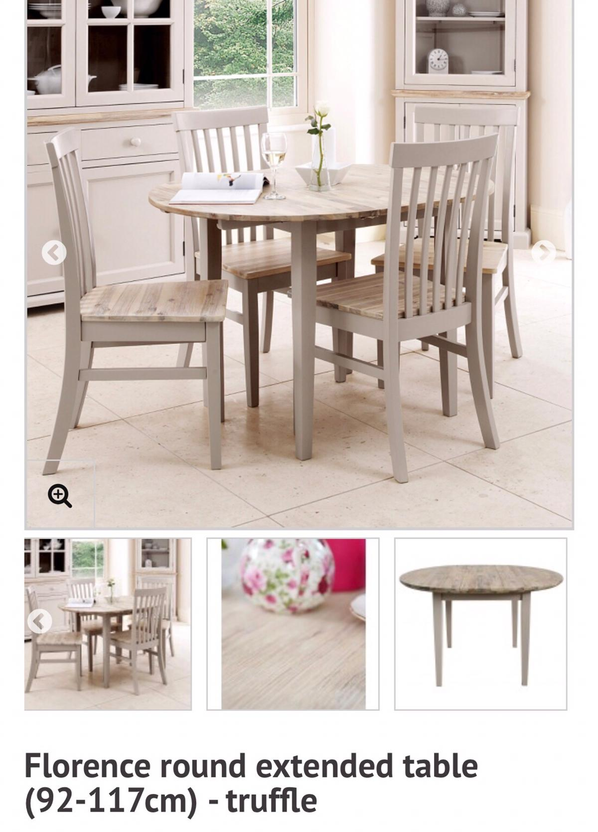 Round Extendable Dining Table And Chairs Set