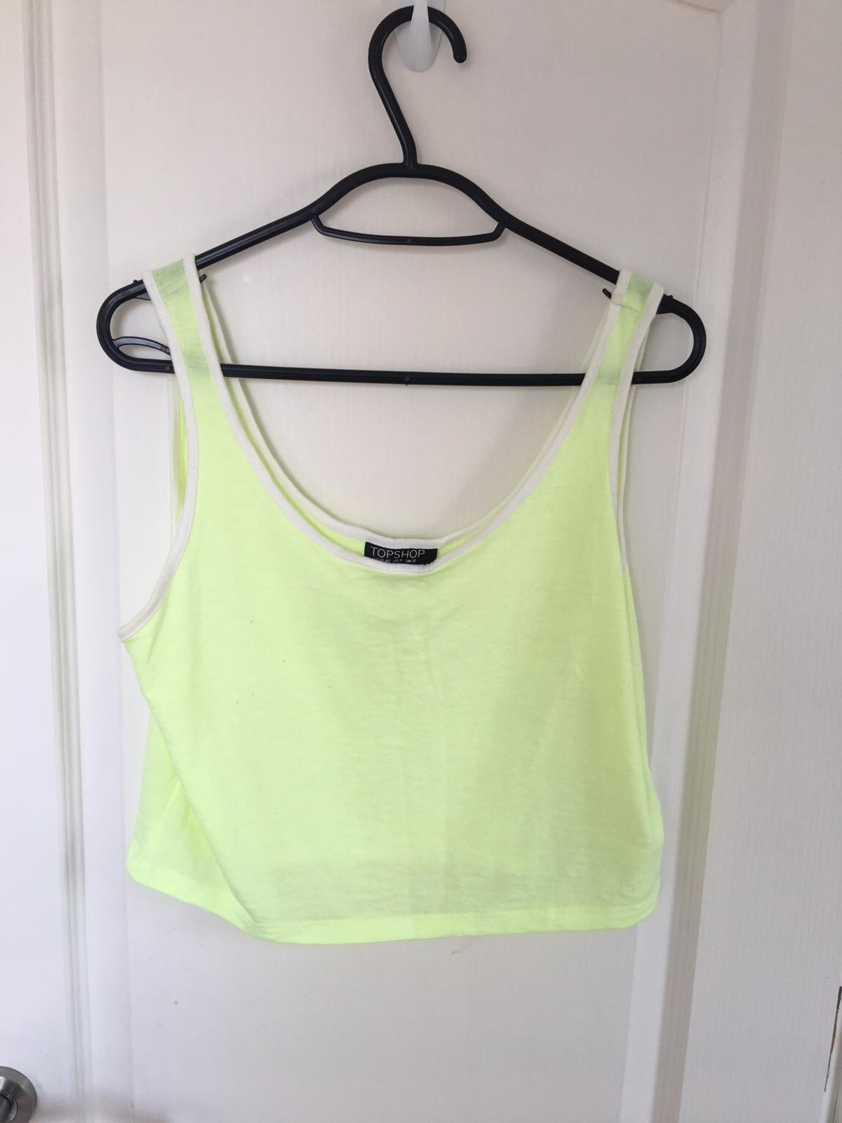 d244c4946a0 Description. Neon yellow and white crop top from Topshop.