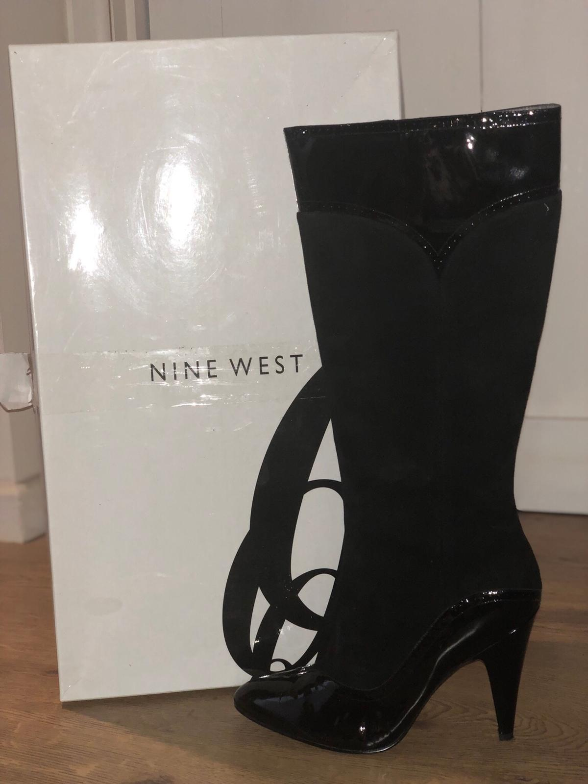 9084d44f32 Description. Black suede and patent heeled boots that have never been worn.