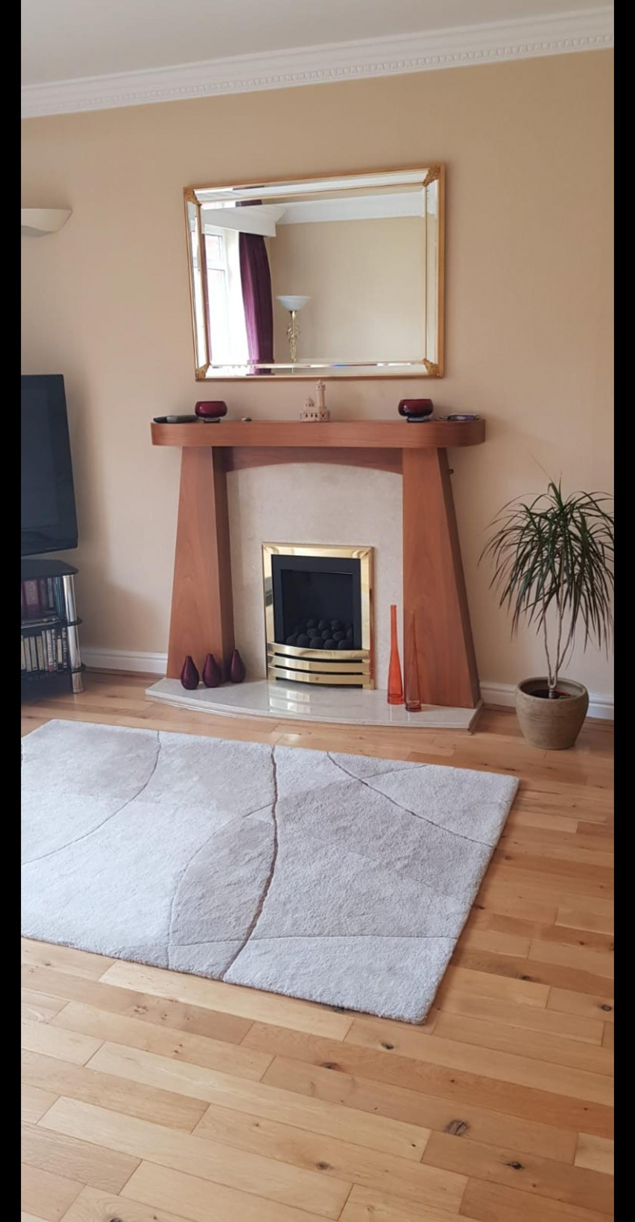 Stylish Modern Wooden Fireplace And Surround In Rochdale For