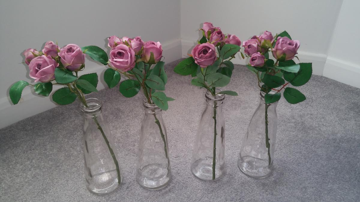 """Decorative bottle top style vase with artificial rose stem. Vase is approx 9""""(H) x 3.5""""(Dia) / 1.75"""" at top.  x3 still available. Price is for x1 (all three for £10)"""