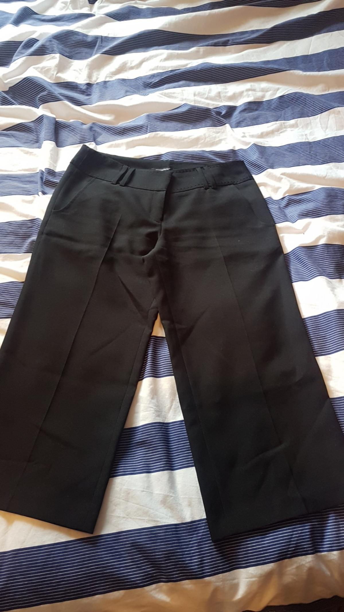 3/4 length black trousers. size 10
