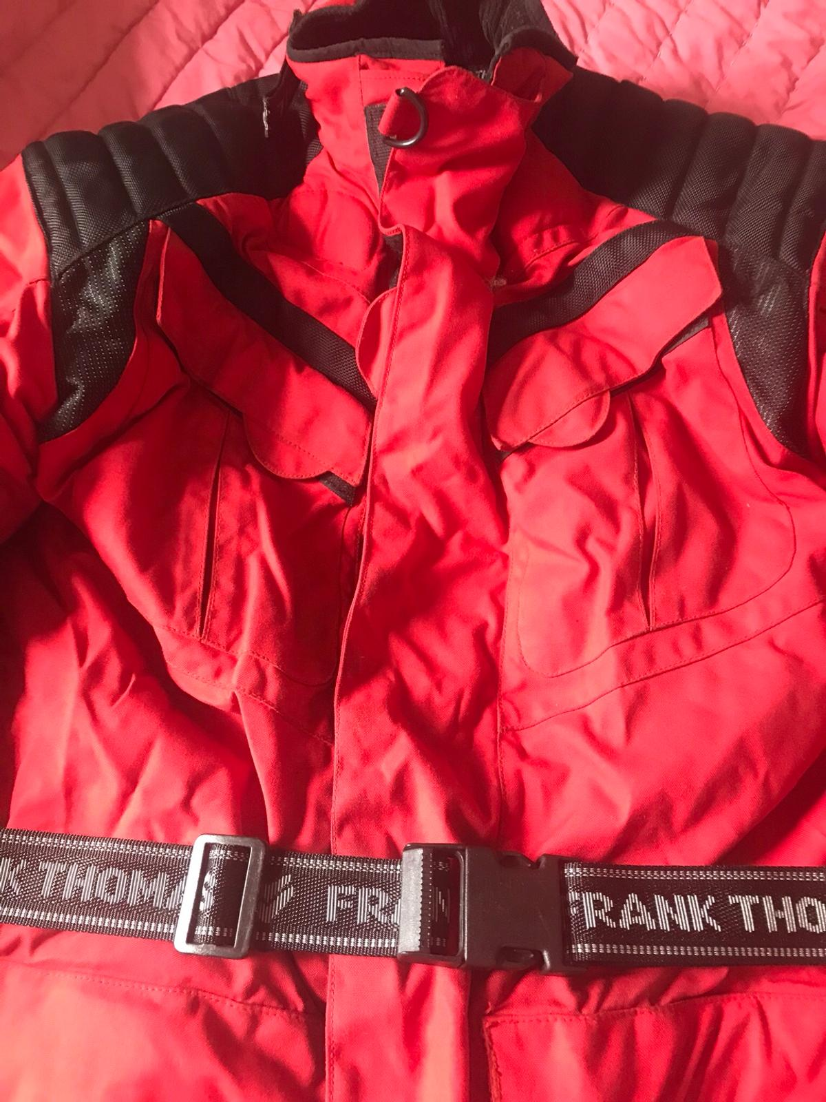 Frank Thomas motorcycle jacket with removable lining, loads of pockets, appropriate armour. Tighten straps to waste, neck and wrists. High collar very warm!