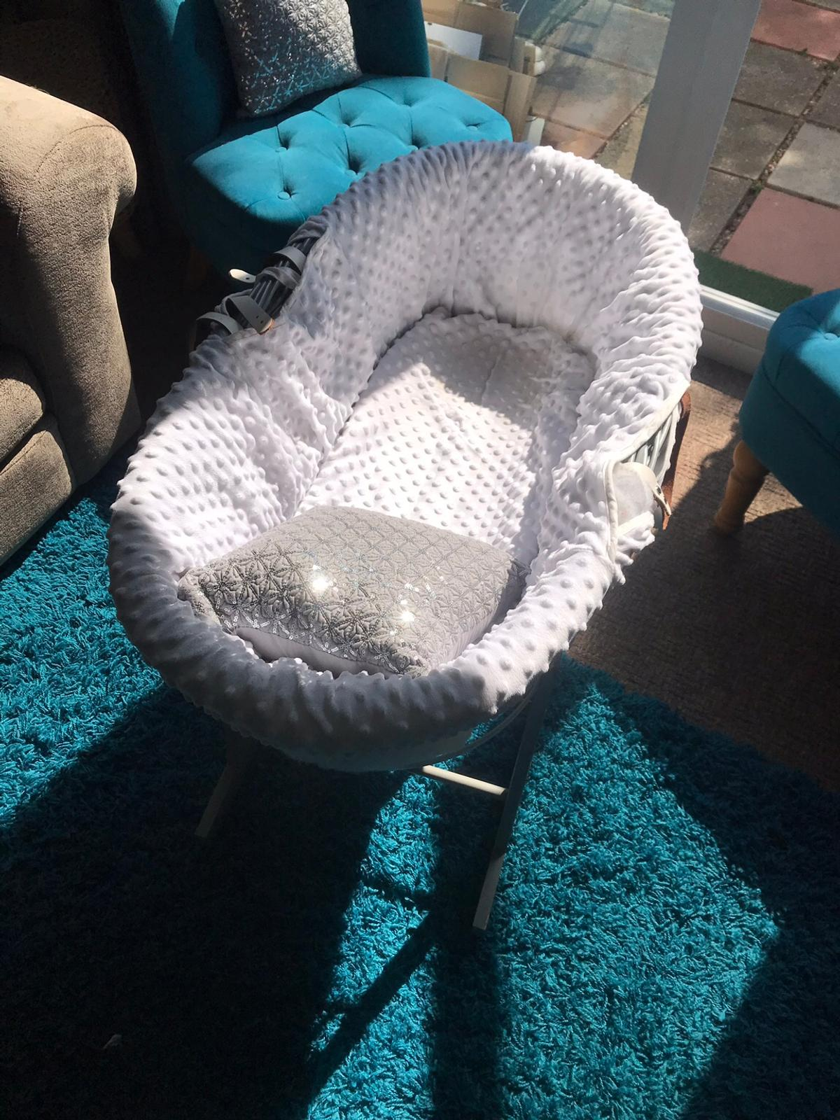 Used but in Excellent condition and at a very Low Price  This Cuddles Collection Dimple Moses Basket is made up of grey wicker basket, dressed in fresh white cotton with a delicate dimpled fabric design.  The Moses Basket is the perfect safe-haven for your child to sleep in for the first few months after birth.  Included with the Moses Basket is rocking stand, mattress,liner,removable hood and a crisp white coverlet. Suitable from birth to 15Kg.  Collection from Slough (SL1). Cash on collection.