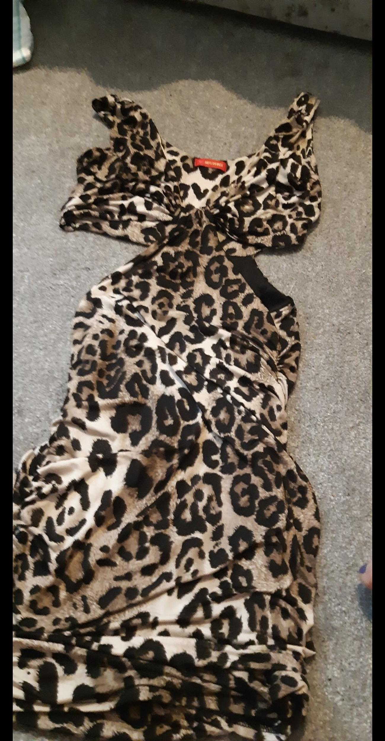 this dress is stunning only worn once for couple of hours stunning on pick up only l10