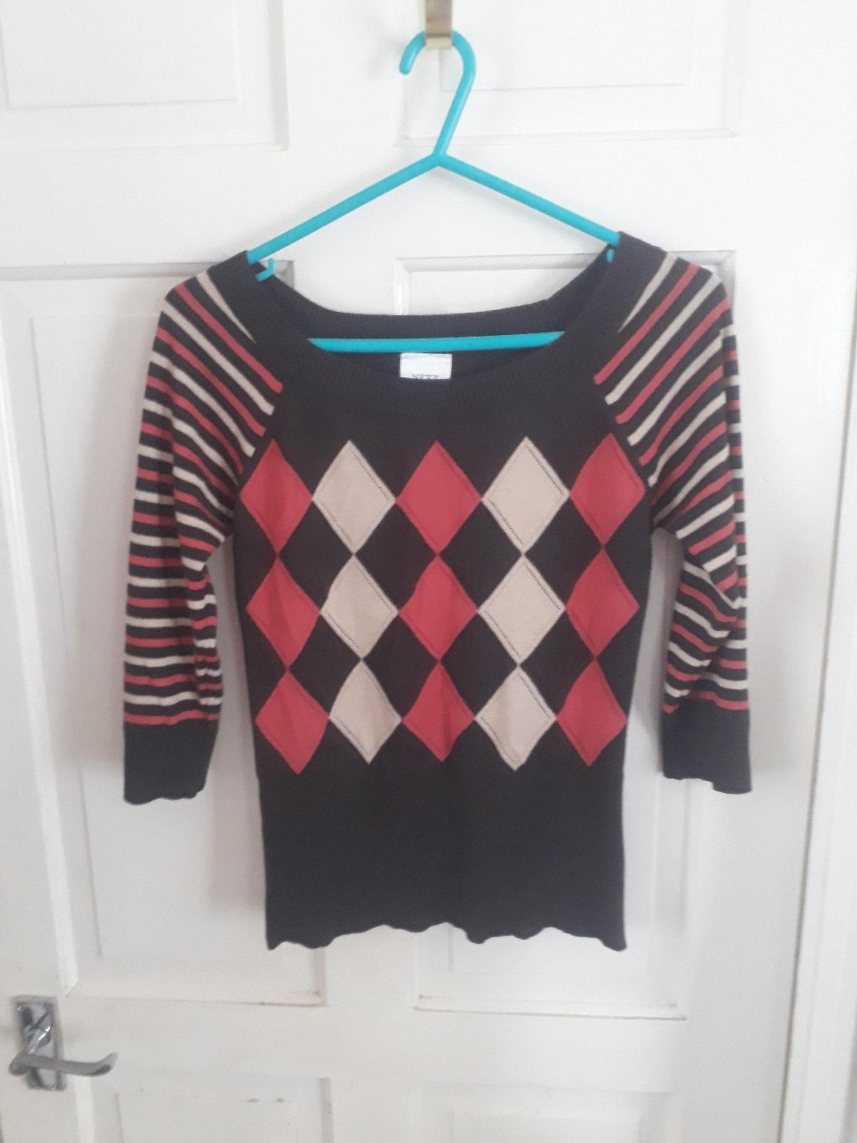 Chocolate colour with 3/4 sleeves. Size 12. From smoke free home. Collection only.