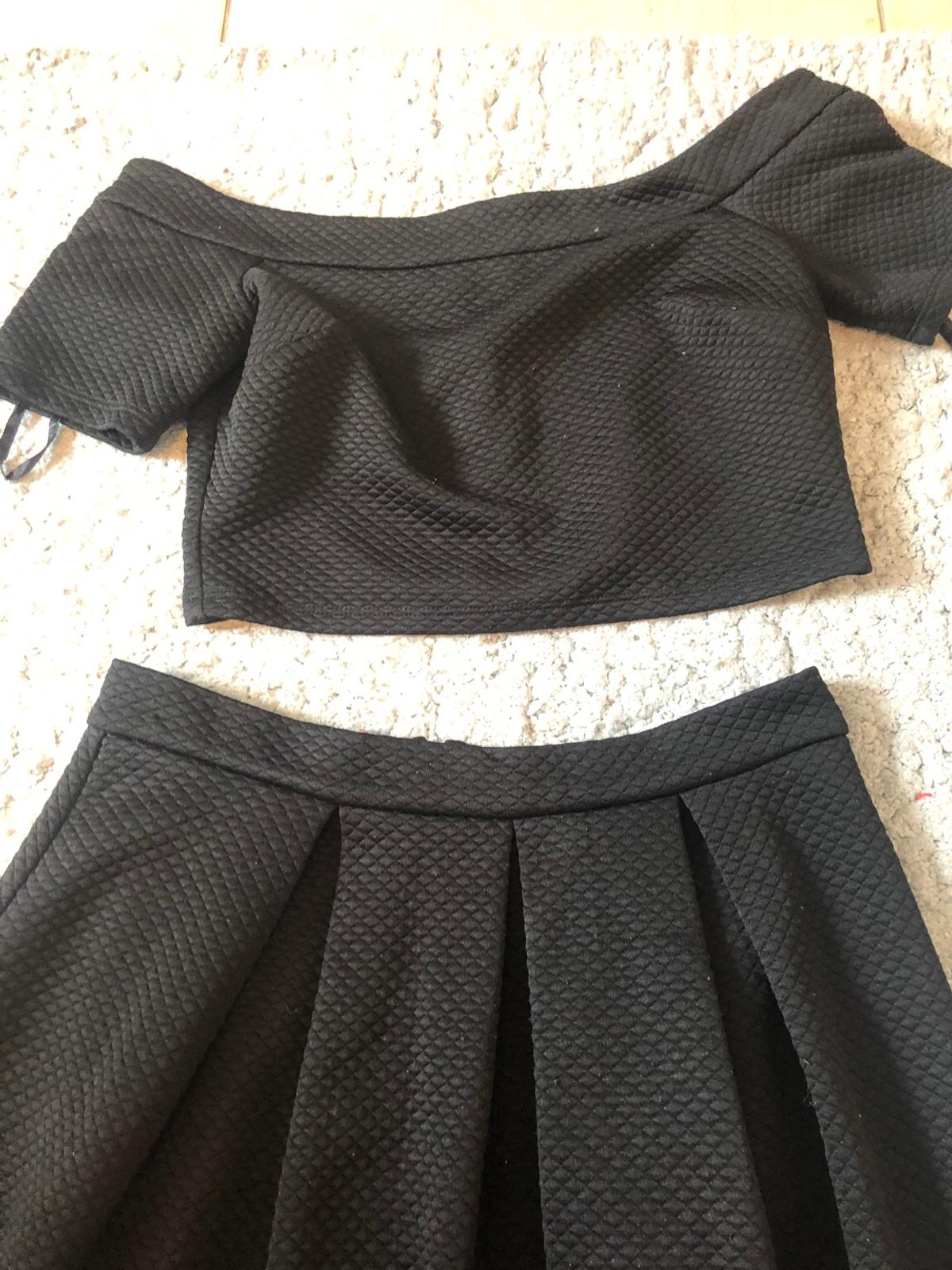 Beautiful river island 2 peice dress. Includes off the shoulder top and mid- skirt. They are both size 12. Like brand new